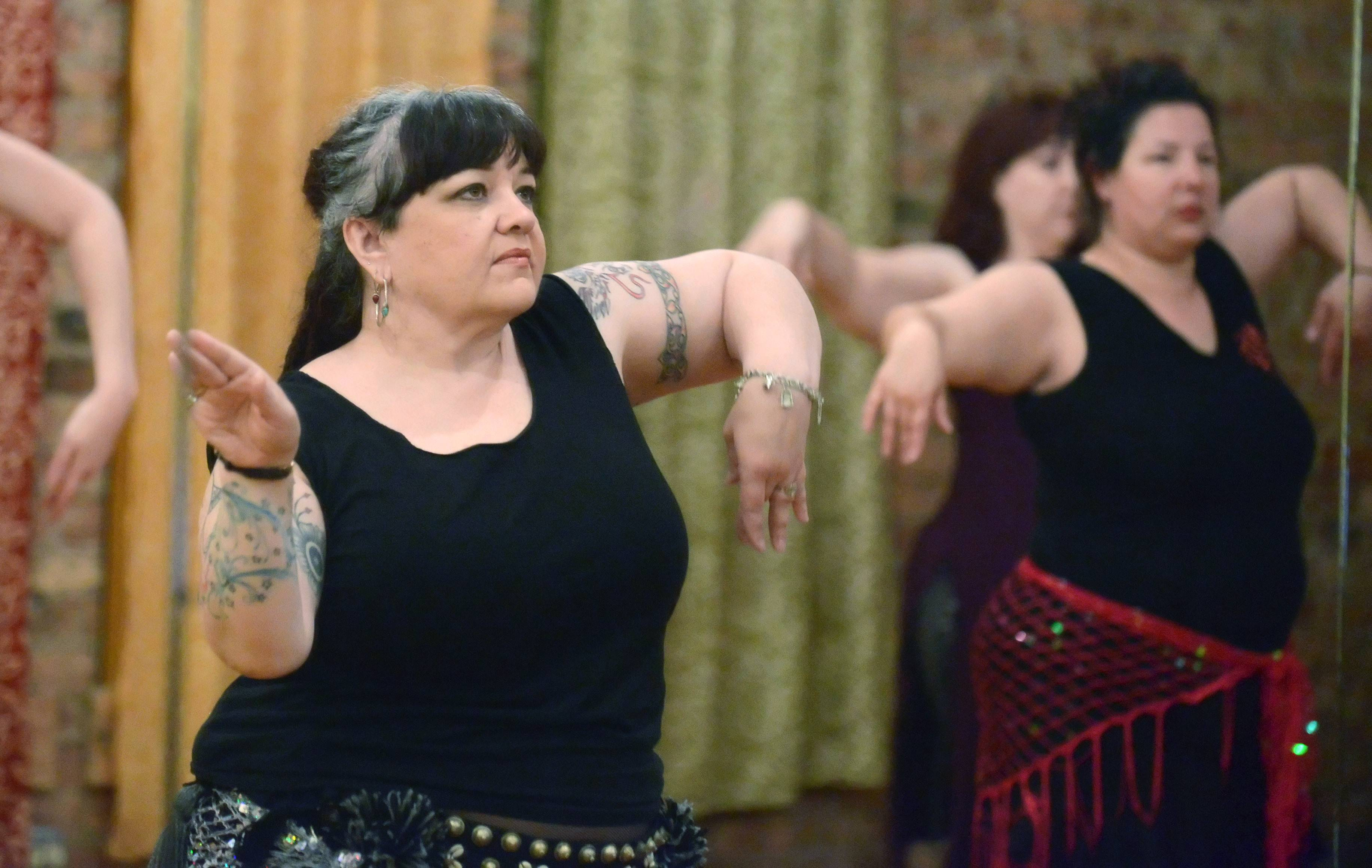 Belly dance instructor and performer Christina King works with students in the Tribal Fusion Level 3 class at her Eastern Grooves Dance Studio in Elgin.