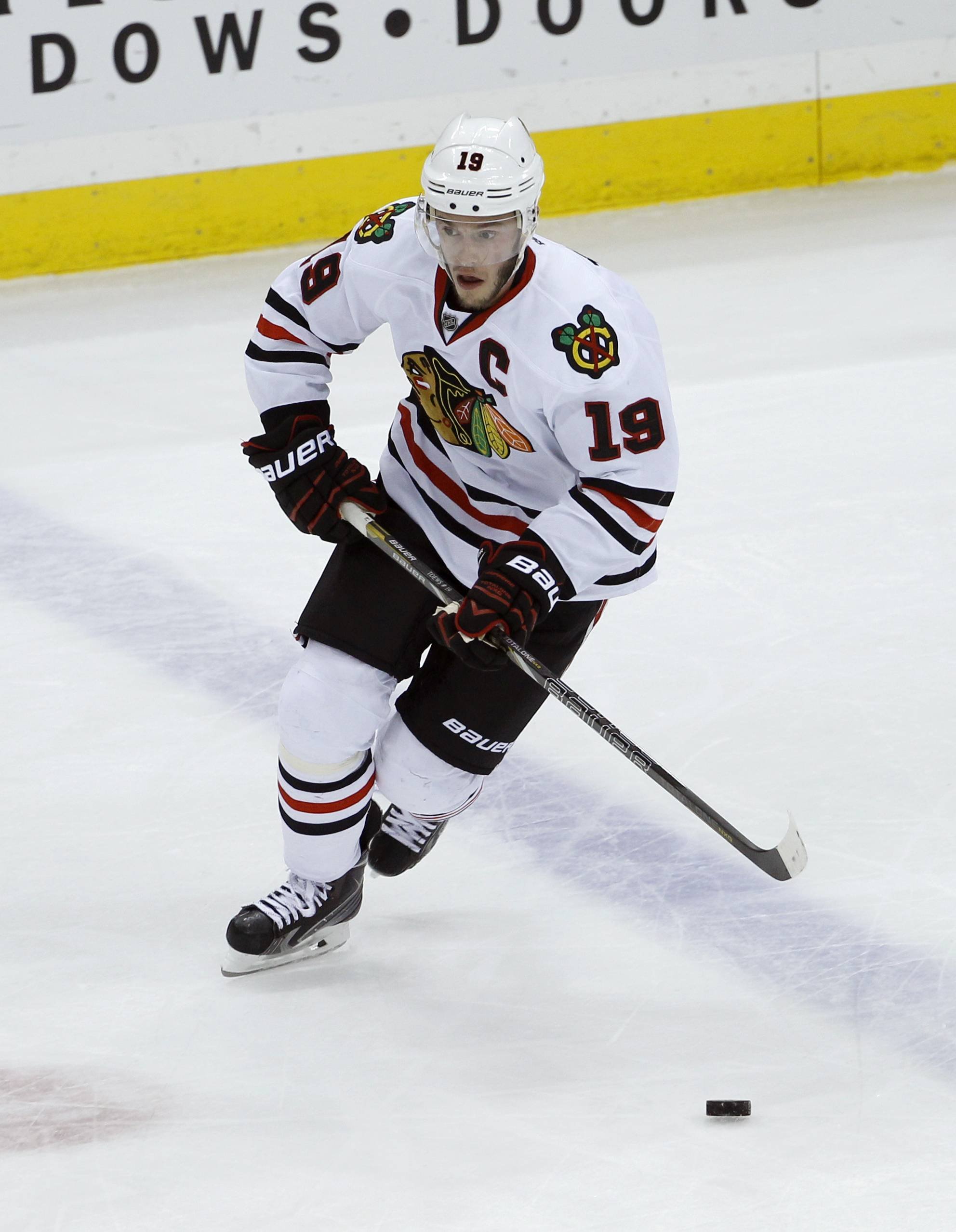 Chicago Blackhawks center Jonathan Toews (19) controls the puck during the first period of Game 6 of an NHL hockey second-round playoff series against the Minnesota Wild in St. Paul, Minn., Tuesday, May 13, 2014. (AP Photo/Ann Heisenfelt)
