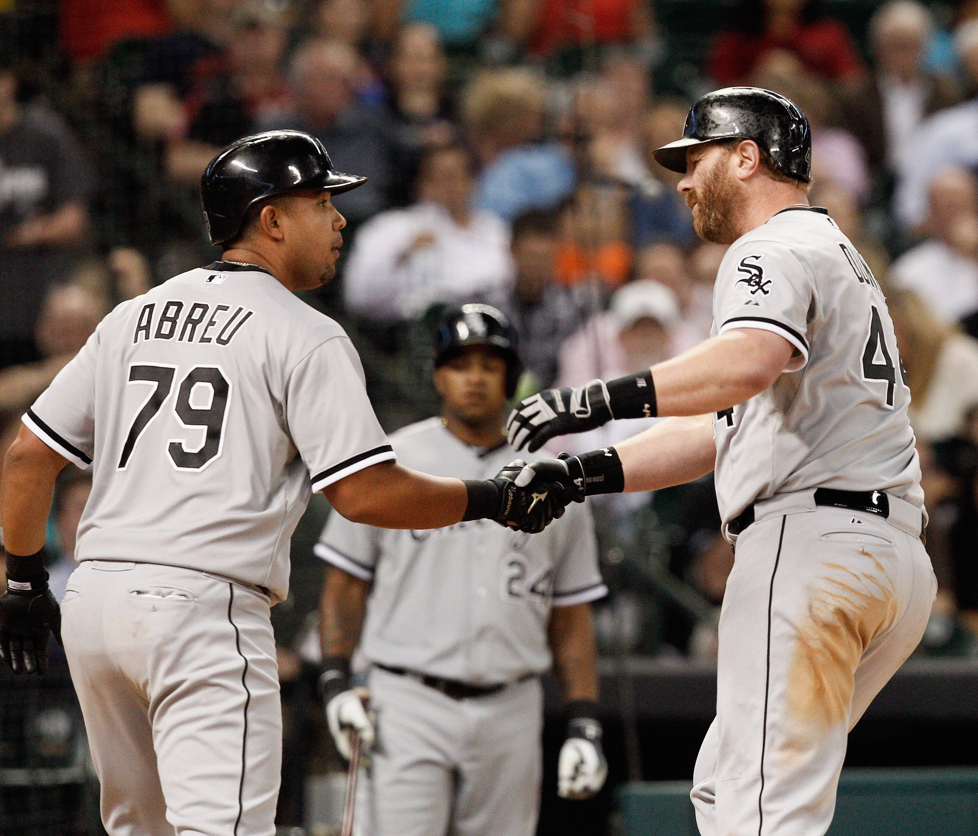 Chicago White Sox's Adam Dunn, right, is congratulated by teammate Jose Abreu, right, after hitting a three-run home run in the sixth inning against the Houston Astros during a baseball game on Friday, May 16, 2014, in Houston. (AP Photo/Bob Levey)