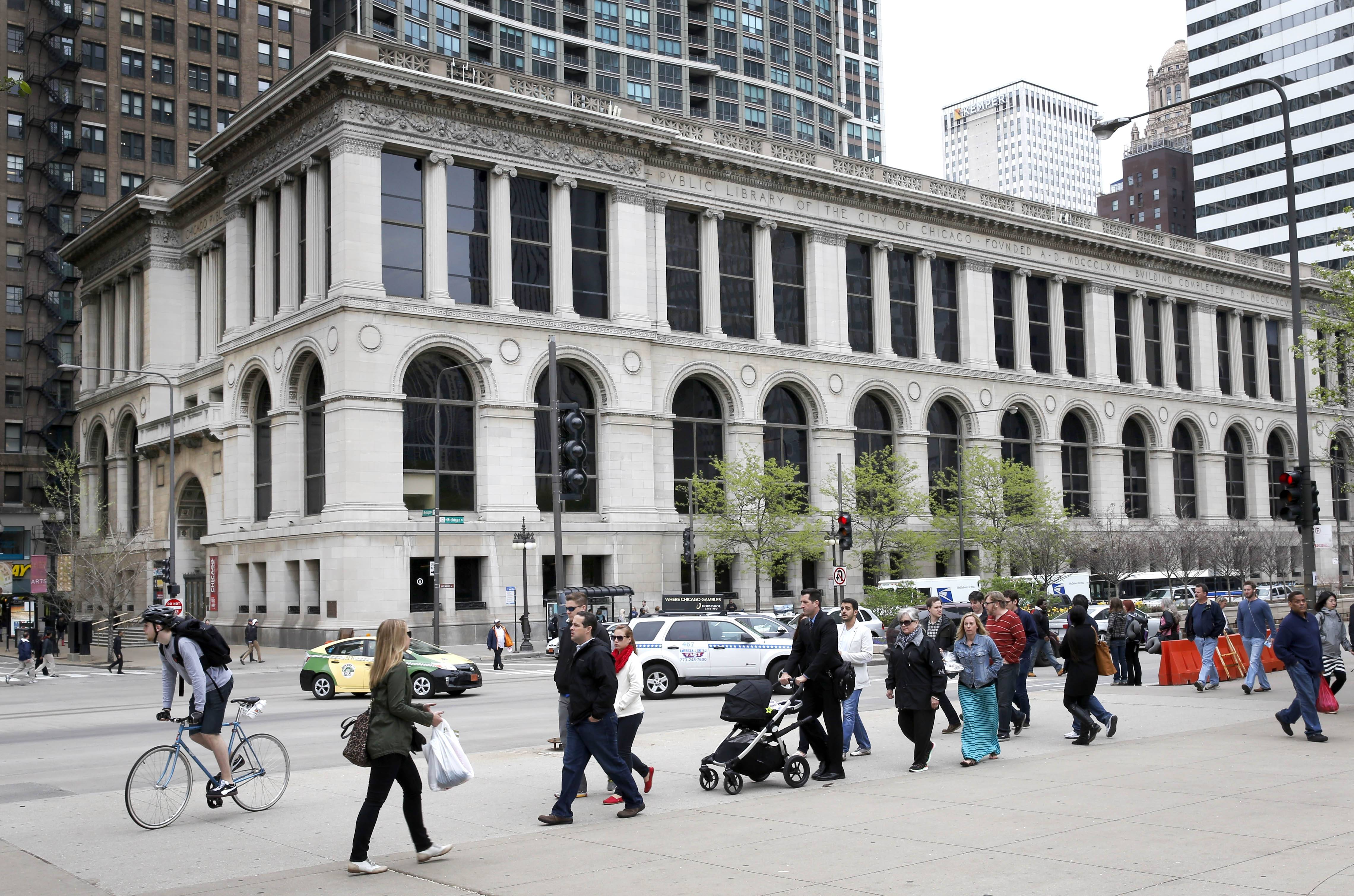 Pedestrians walk past the Chicago's Cultural Center, which is part of the Retrofit Chicago deal with Bank of America. It is expected to save about $1.5 million annually in utility costs.