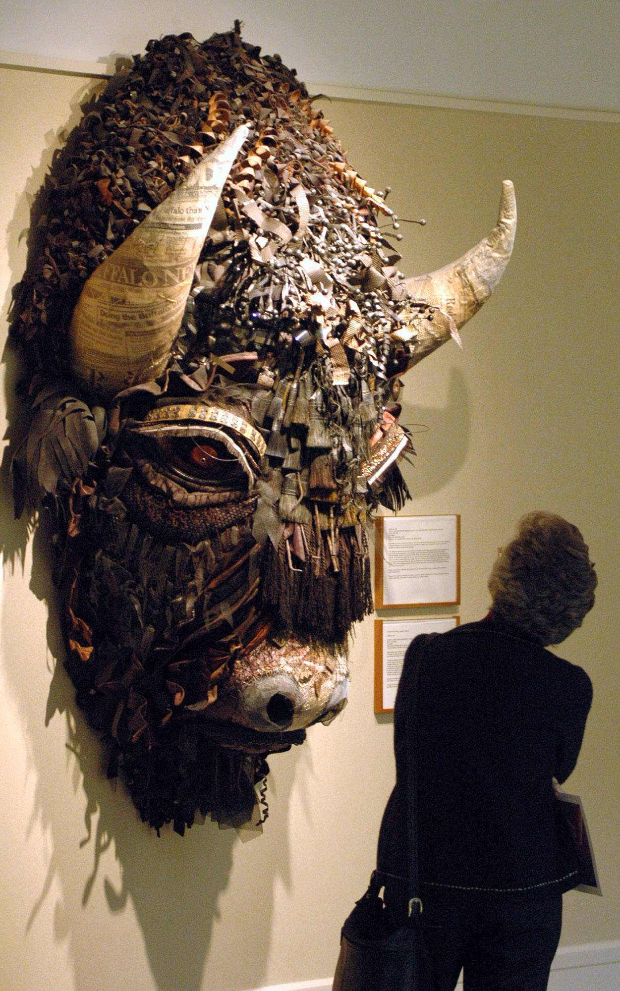 A tourist looks at Buffalo, a mixed media piece by artist Holly Hughes, which is part of the Capitol Art Collection at the Capitol in Santa Fe, N.M. The collection was created in 1991 and consists of nearly 600 works exhibited in the building's public spaces and on the grounds outside. The collection is currently valued at more than $5.6 million.