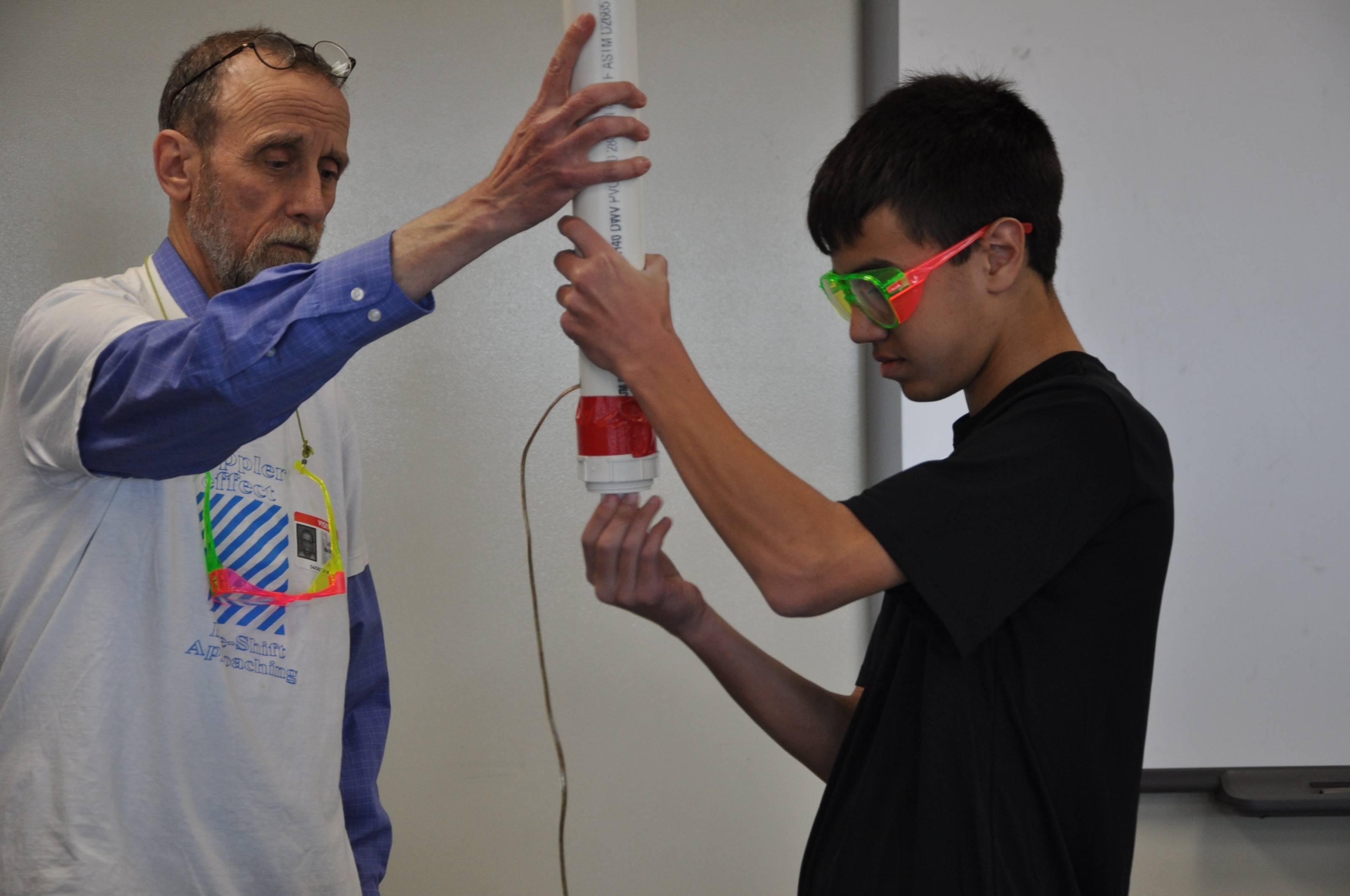 "Jay Bhatia, an eighth-grader at Jefferson Junior High in Naperville Unit District 203, loads a T-shirt shooter with retired Naperville North chemistry teacher Lee Marek during a practice for a possible appearance Tuesday on the ""Late Show with David Letterman."" Jay and four other students will audition for producers and three of them will get to be on the show."
