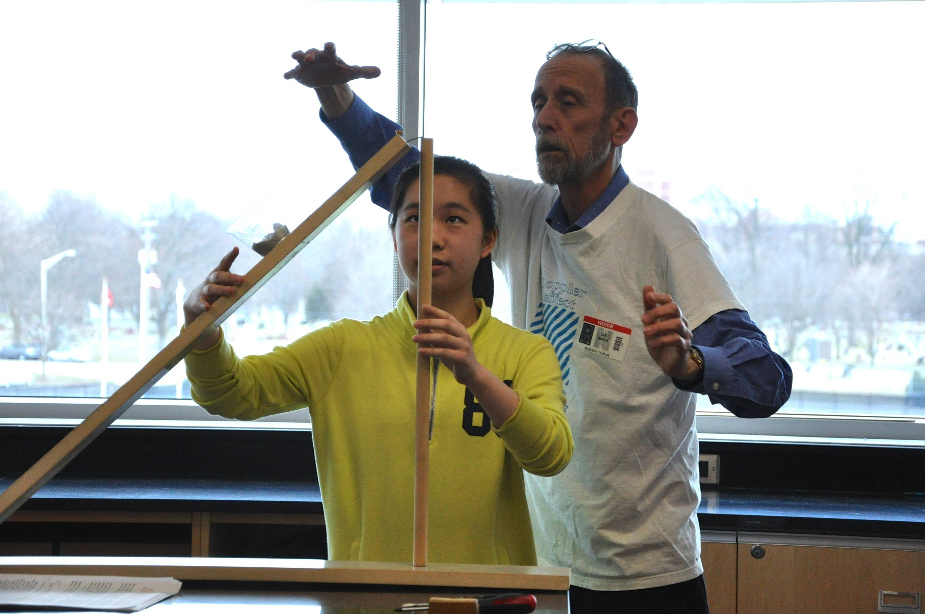 "Naperville Central High School sophomore Samantha Xu and retired Naperville North chemistry teacher Lee Marek set up equipment for a science demonstration that might make it to the ""Late Show with David Letterman."""