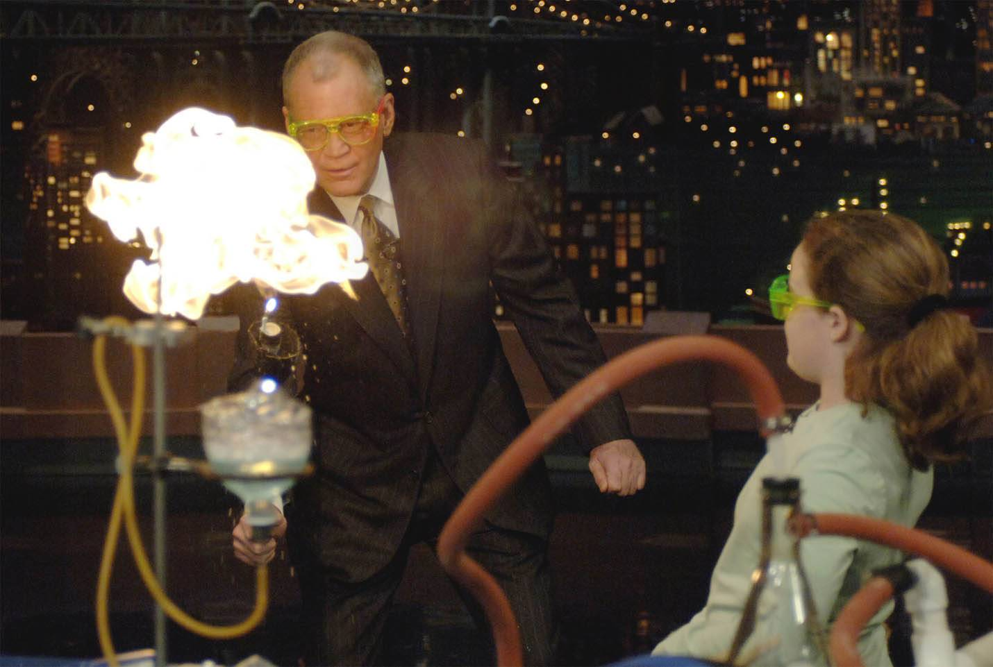"""Late Show"" host David Letterman performs a methane bubbles experiment as Jefferson Junior High sixth-grader Melissa Melloy watches during one of the past kid scientist appearances made by students from Naperville Unit District 203."