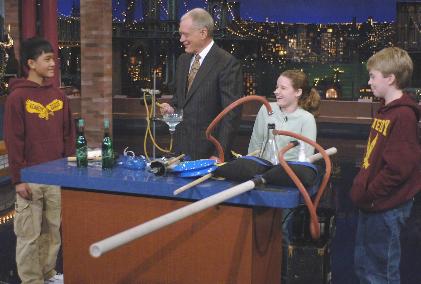 "Students from Kennedy Junior High in Naperville Unit District 203 appear on ""The Late Show with David Letterman"" in one of 22 cameos the district's students have made on the show during the past 17 years."