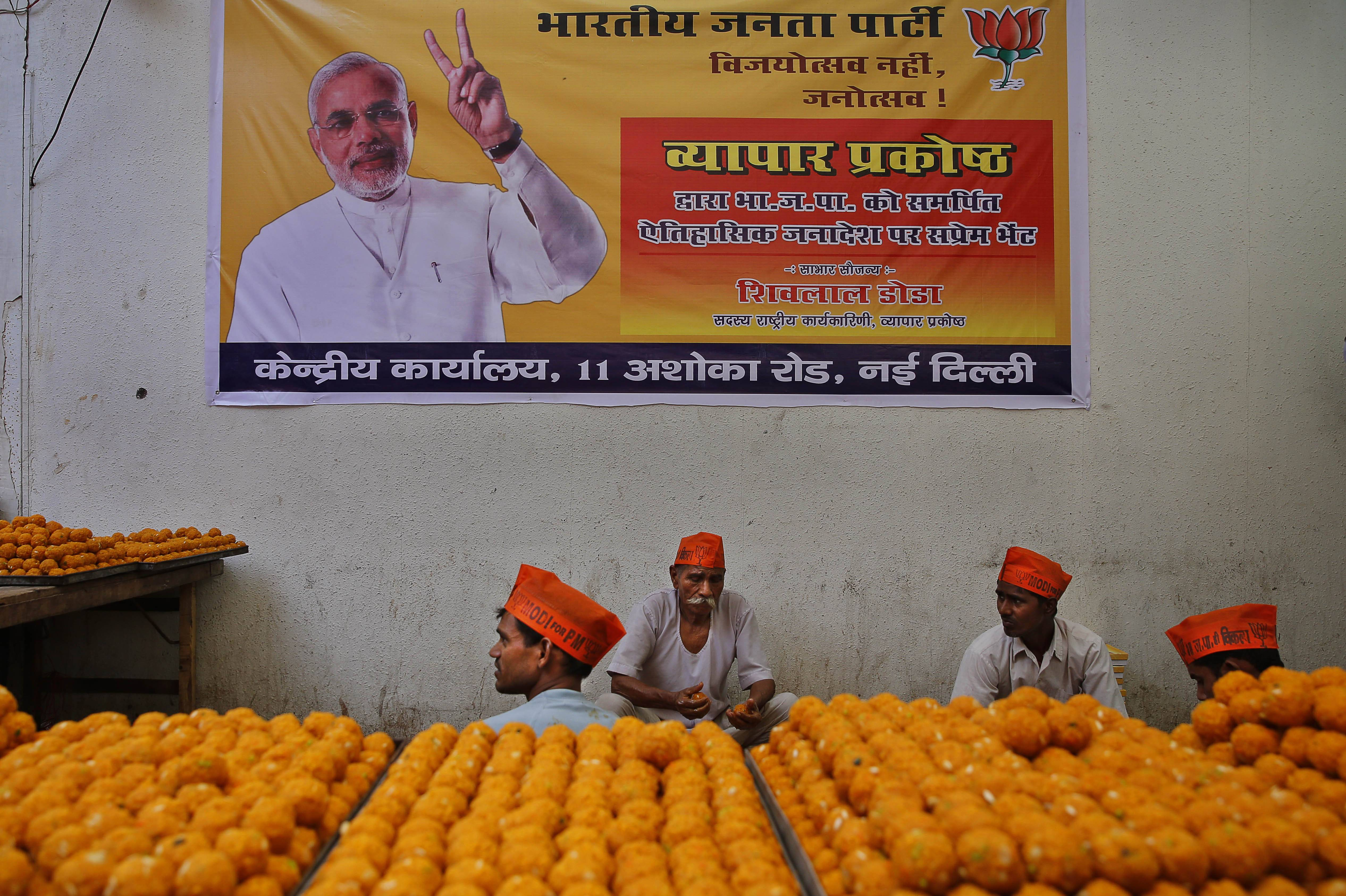 Indian workers prepare sweets Thursday, anticipating election victory for the Bharatiya Janata Party (BJP) at the party's headquarters, in New Delhi, India.