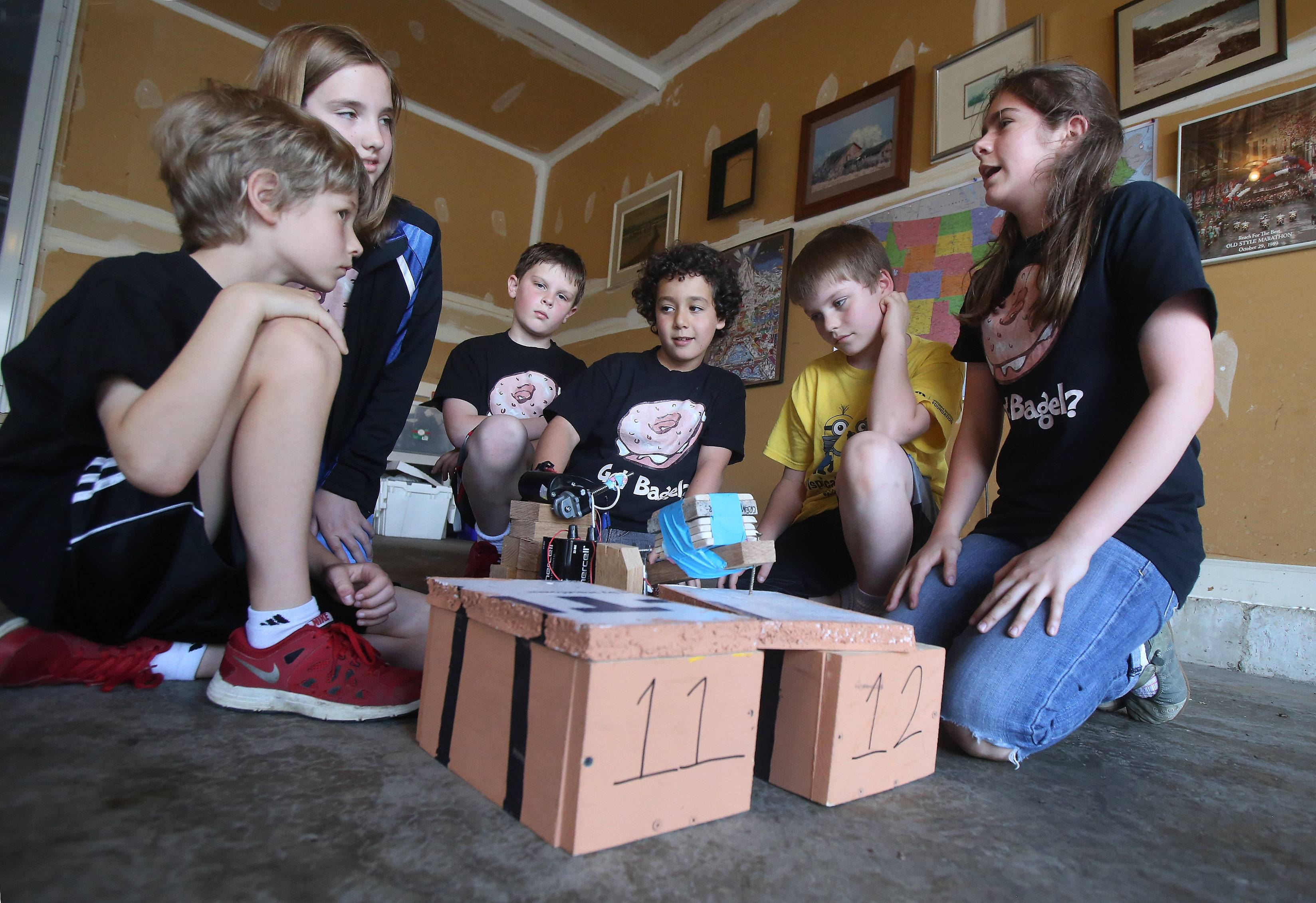 Chase Hauser, left, Lily Ervine, Ryan Canter, Noah Scally, Eric Sparks and Celia McDermott-Hinman, from a combined Adler Park and Butterfield elementary team, with their project for Destination Imagination in Libertyville.