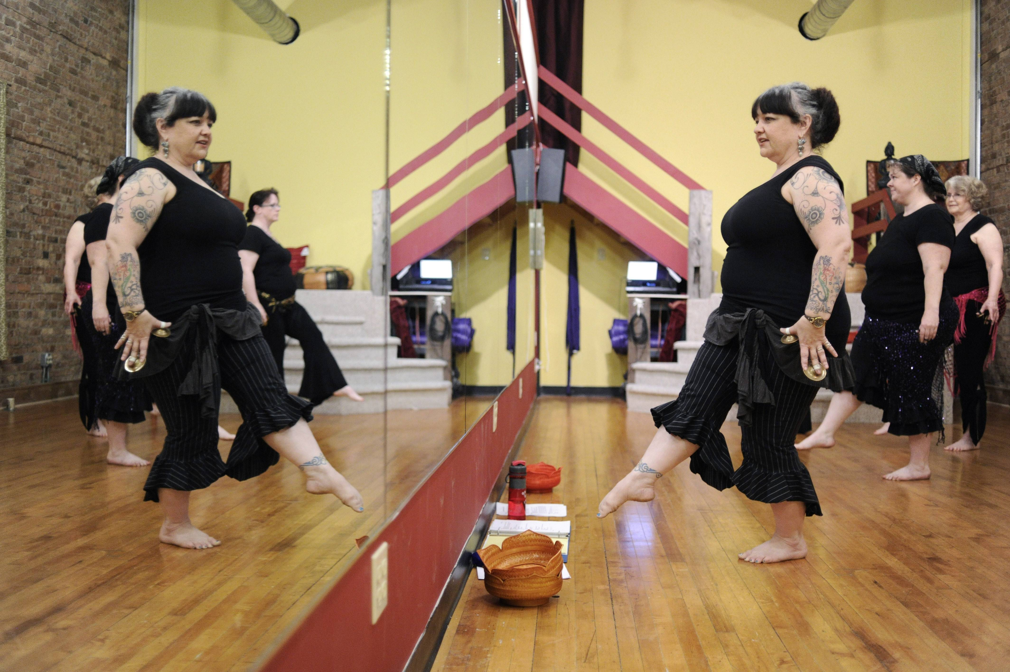 Belly dance instructor Christina King leads students in the Sunday evening class at Eastern Grooves Dance Studio in Elgin.
