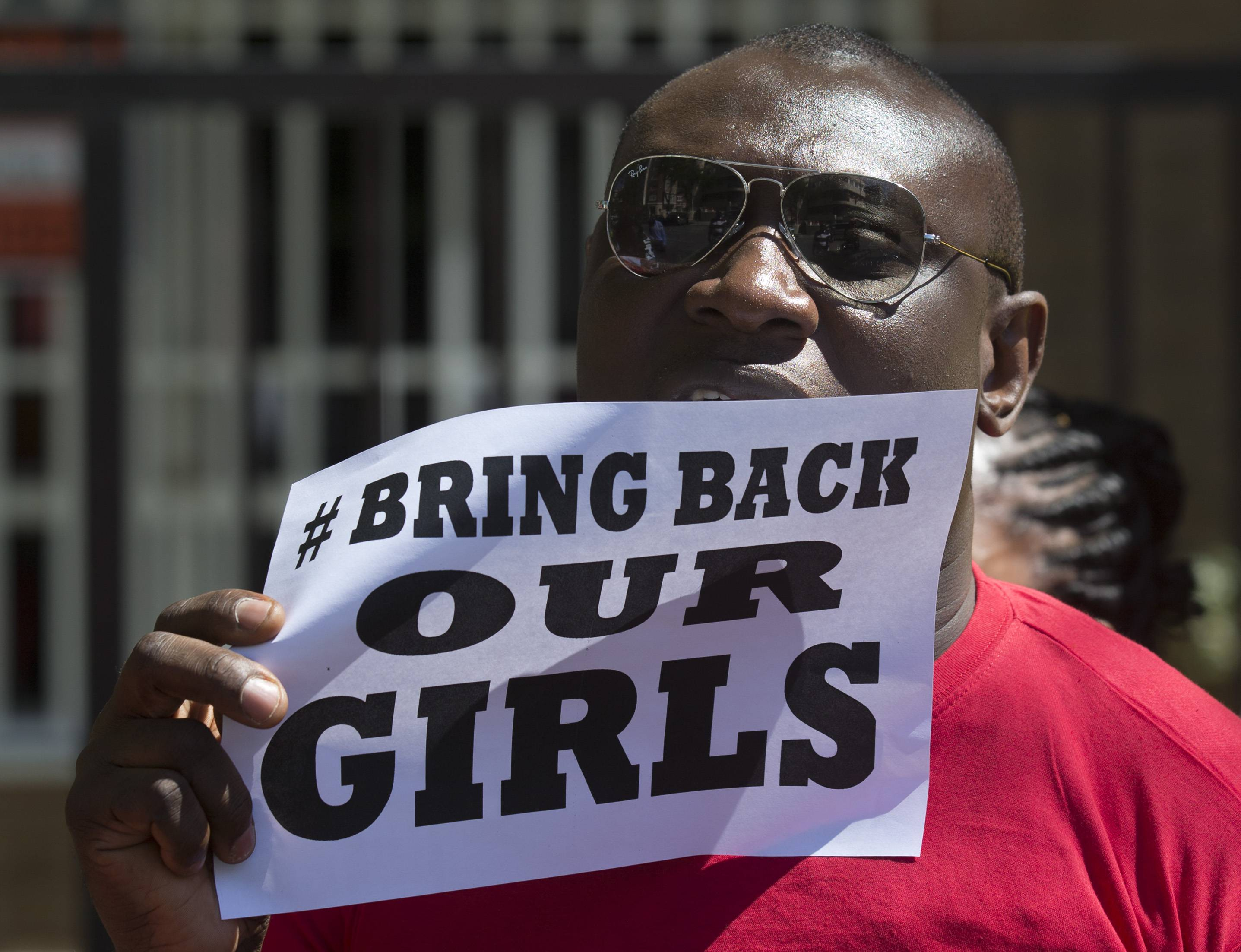 A Nigerian, resident in Spain protests outside the Nigerian embassy in Madrid, Spain, Friday, May 16, 2014 in support of the kidnapped school girls in Abuja, Nigeria.