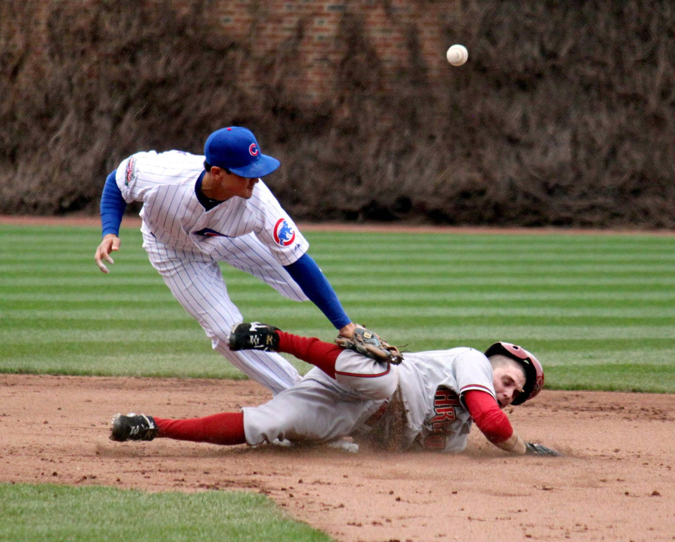Tony Campana of the Arizona Diamondbacks steals second base against the Chicago Cubs as the ball gets away from Darwin Barney on April 24.