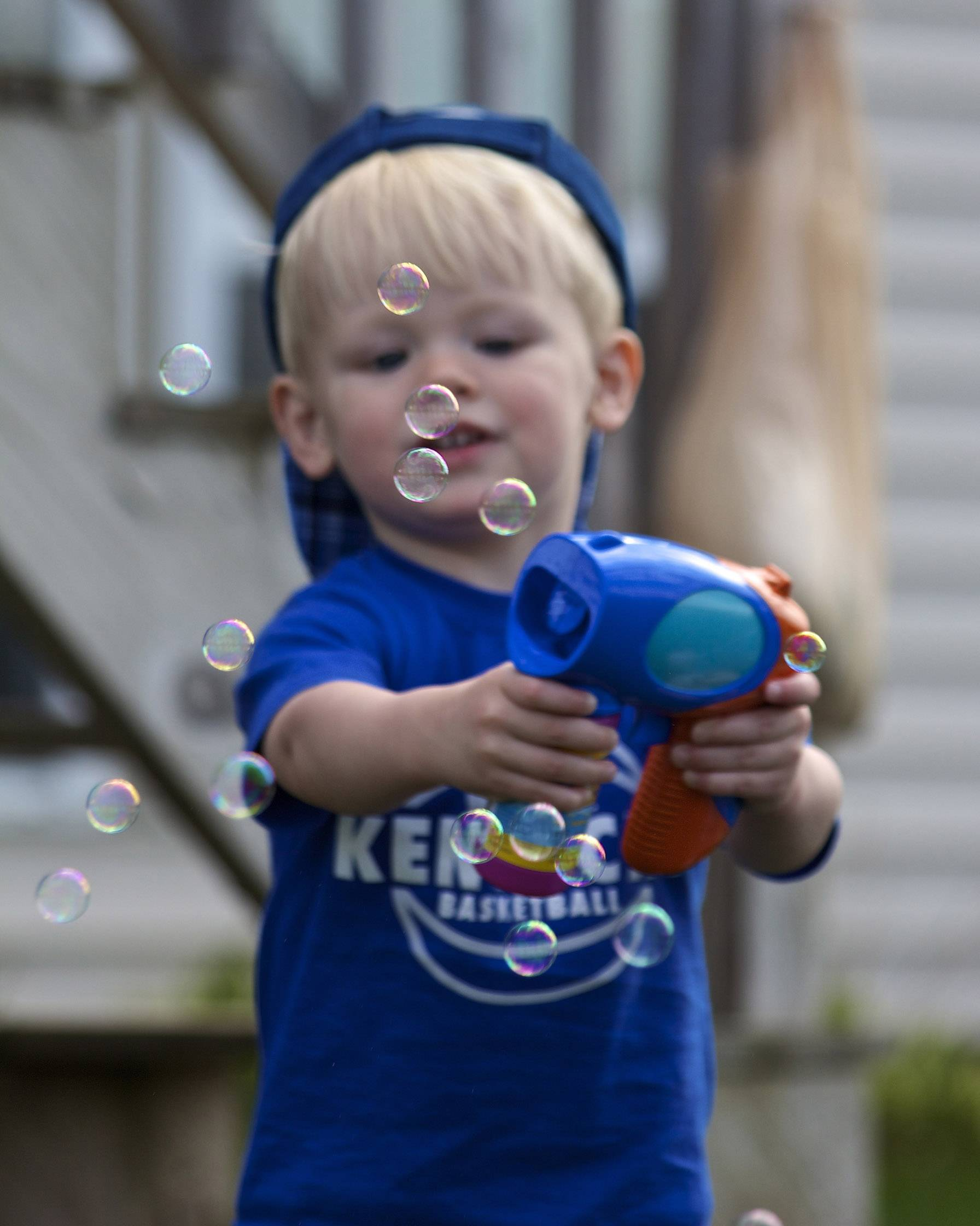 Two-year-old Drew Sriver plays with a bubble machine on Mother's Day in Libertyville.