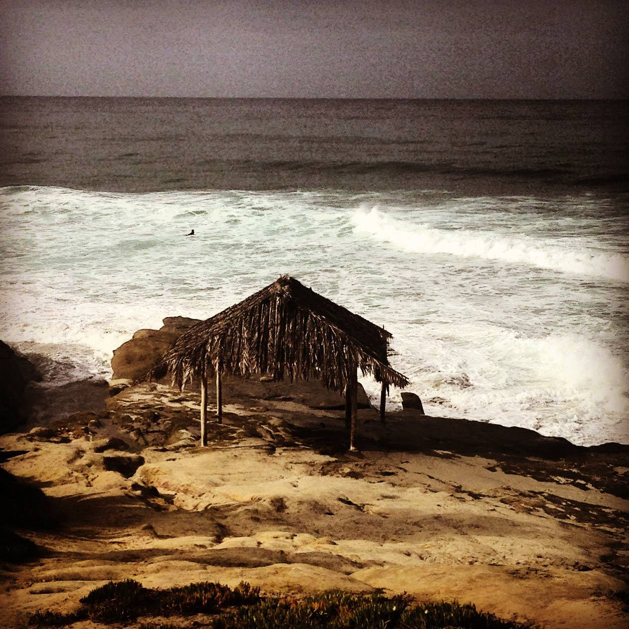 "The famous surfing Beach Windansea in La Jolla, California including the historical  ""Shack"" that was constructed in 1946."