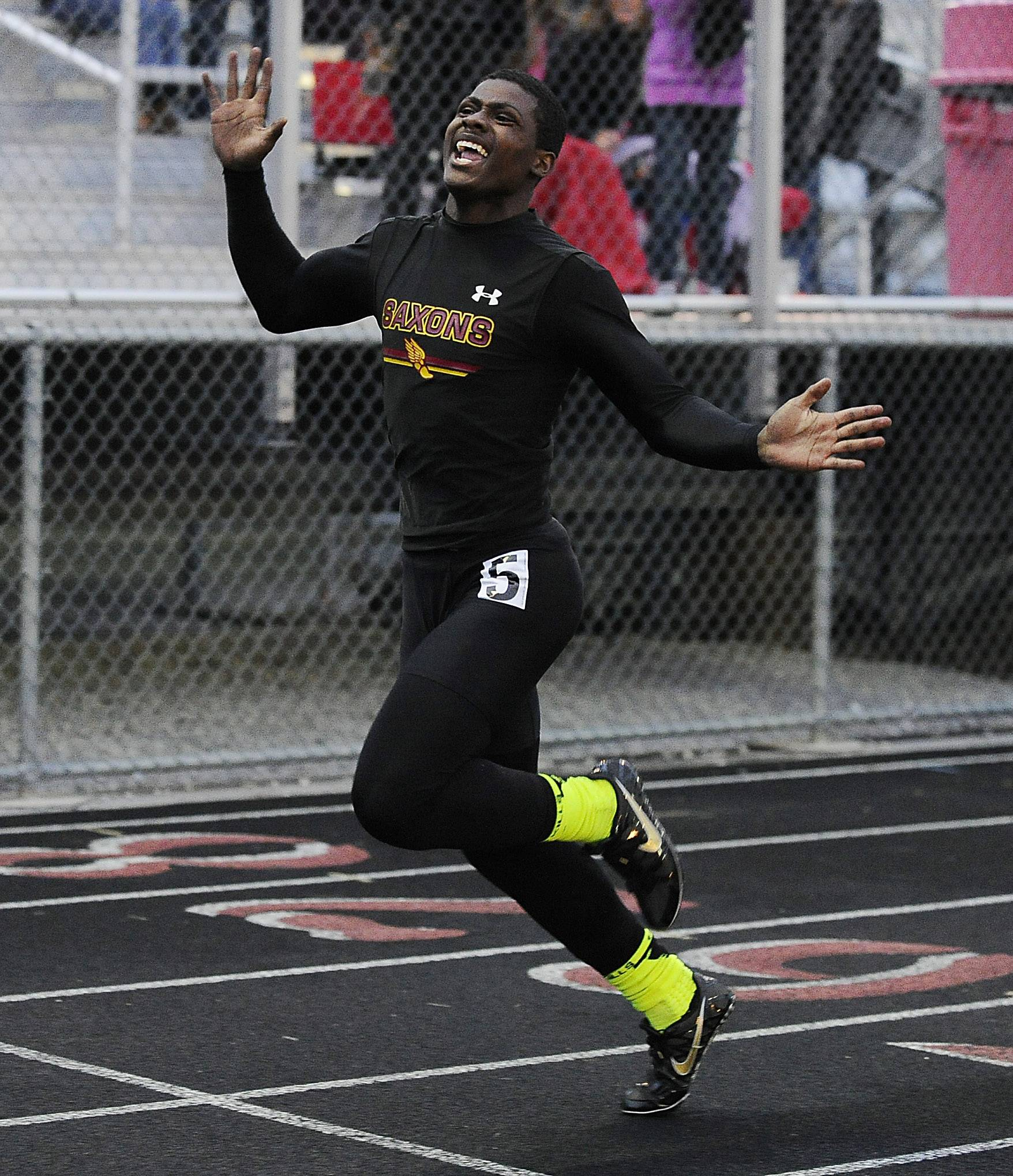 Schaumburg's Shandall Thomas takes the 100-meter dash during the Mid-Suburban League meet Friday at Palatine.