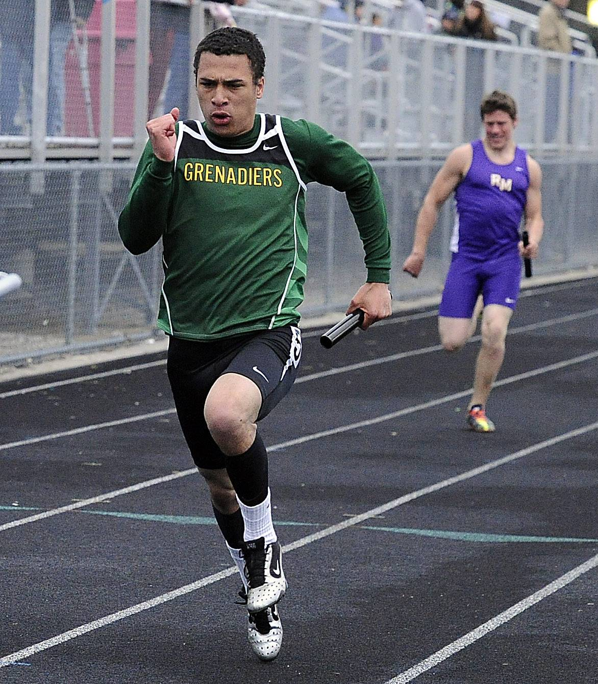 Heat one of the 400-meter relay found Elk Grove's John Pass winning at the MSL varsity Track and Field contest at Palatine High School on Friday.