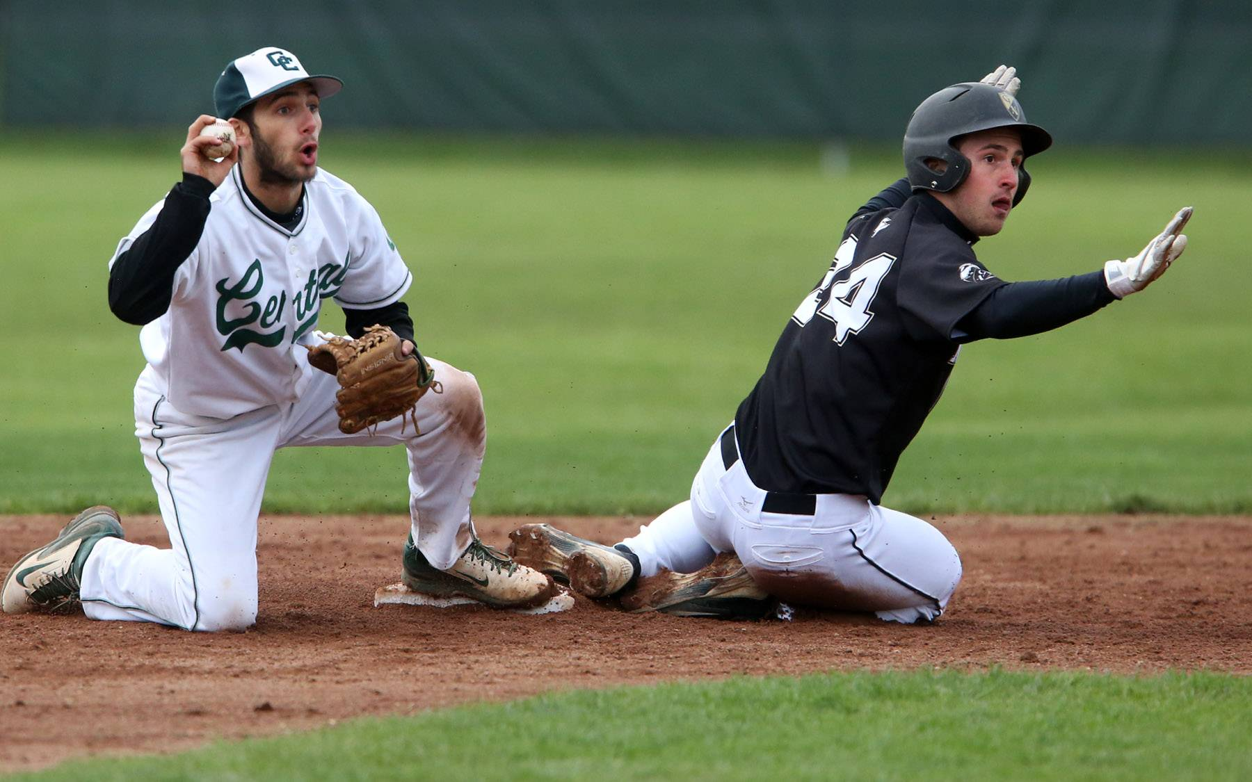 Grayslake North's Andrew Mikusa is called out after Grayslake Central second baseman Jay Hoffmann was able to scoop up a dropped ball on Friday at Grayslake Central.