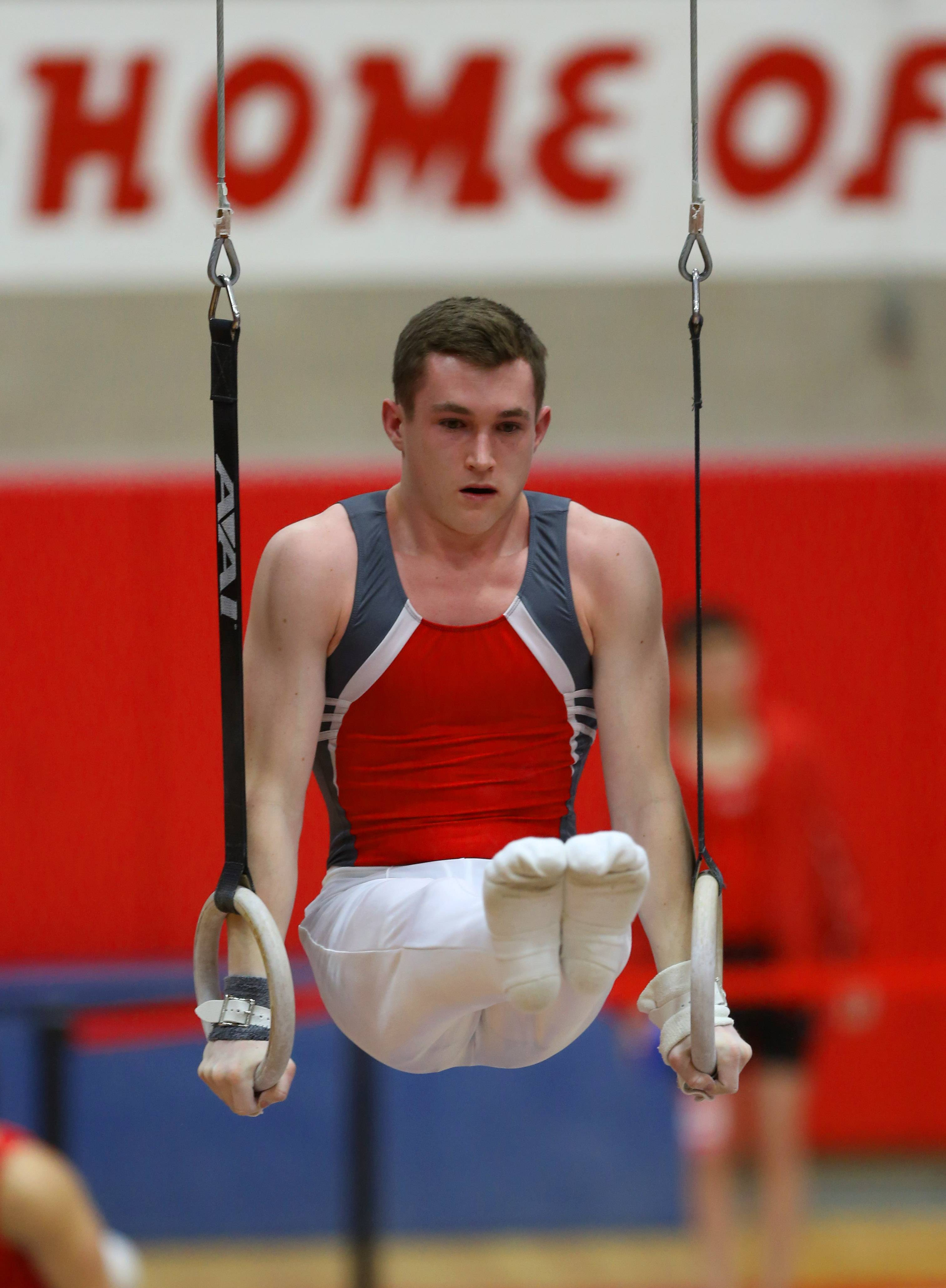 Mundelein's  Cameron Mueller performs his still rings routine during the boys gymnastics state meet Friday at Hinsdale Central.