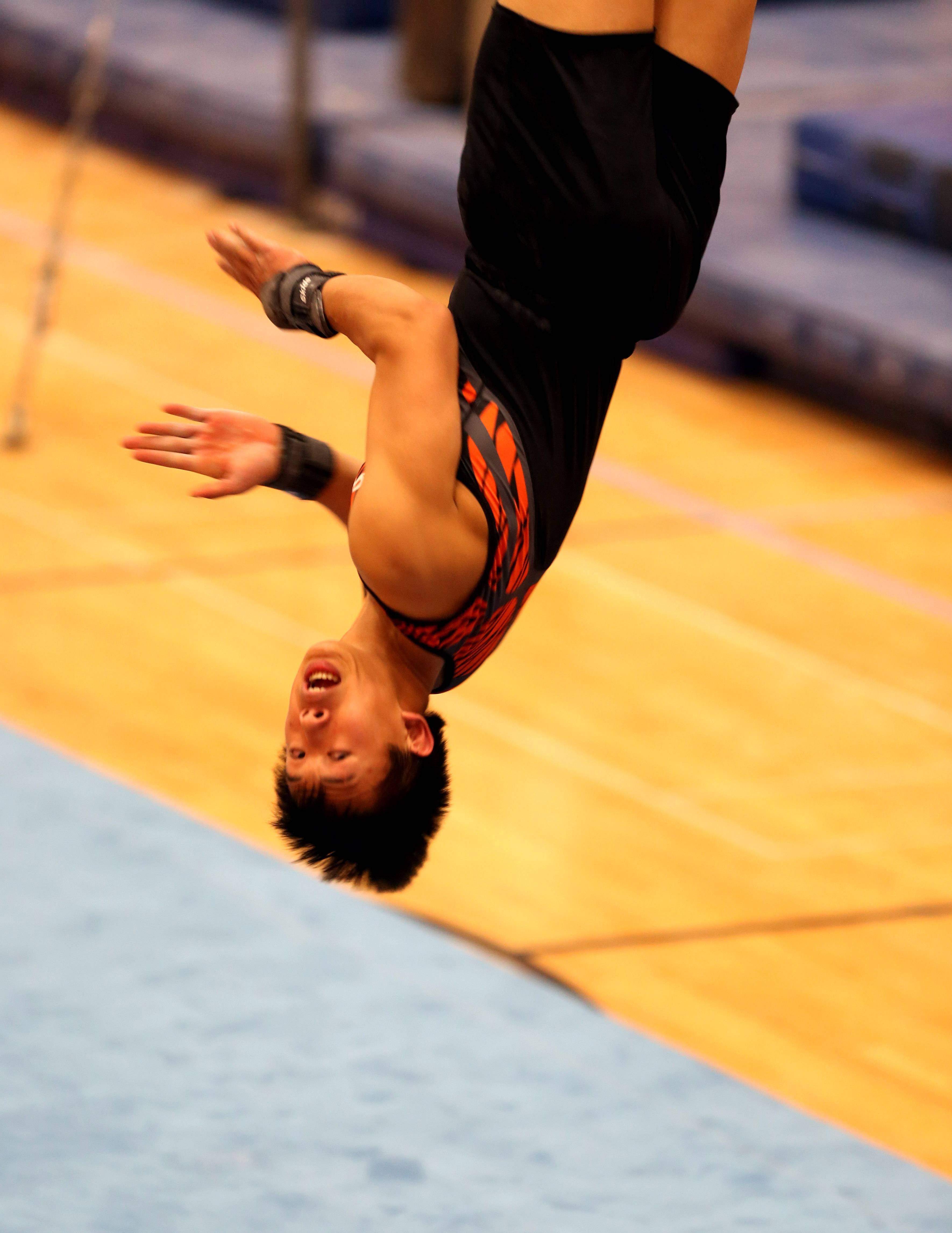 Libertyville's Alex Pong performs his floor excercise routine during the boys gymnastics state meet Friday at Hinsdale Central.