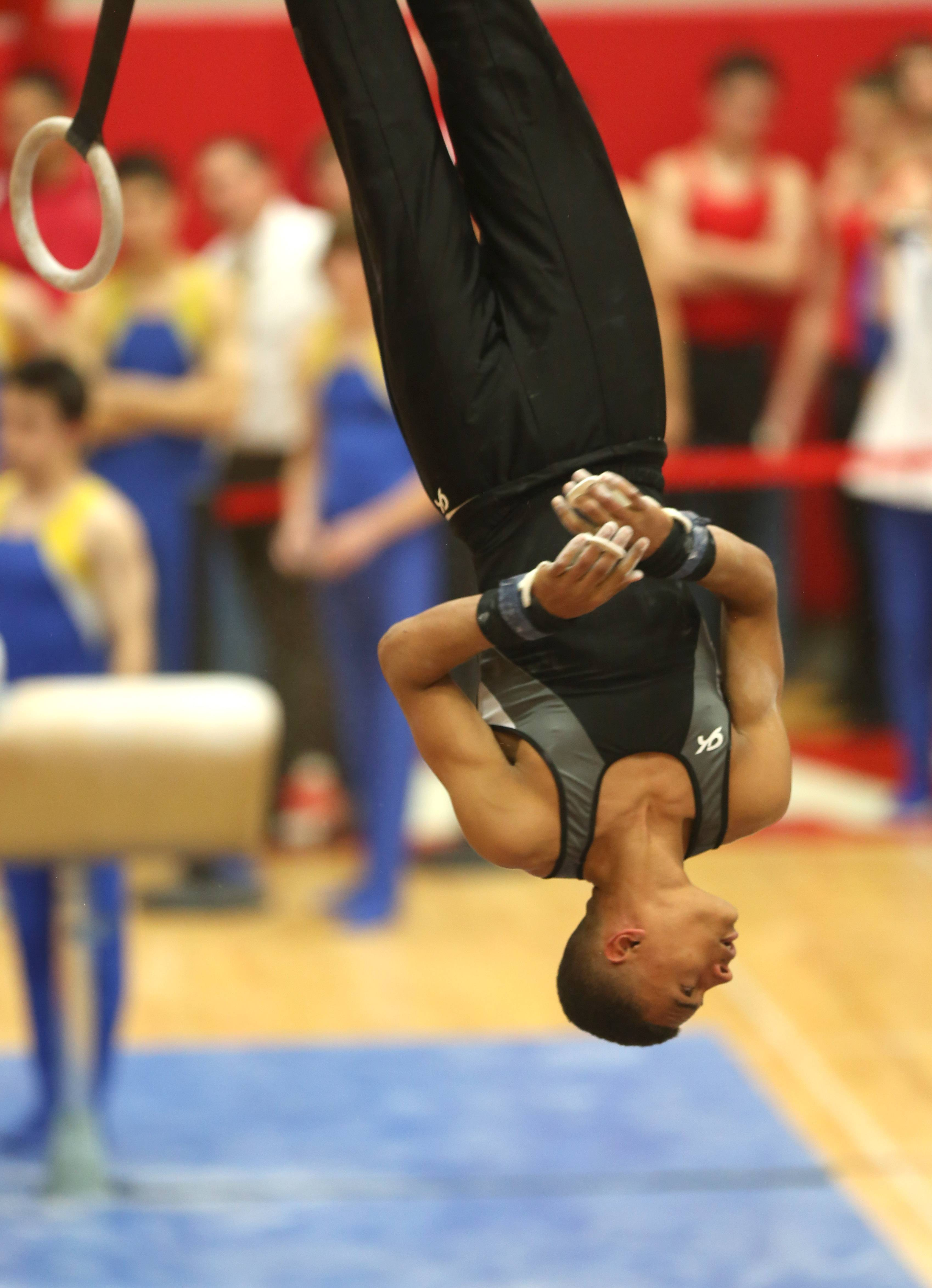 Elgin's Nolan Williamson performs his still rings routine during the boys gymnastics state meet Friday at Hinsdale Central.