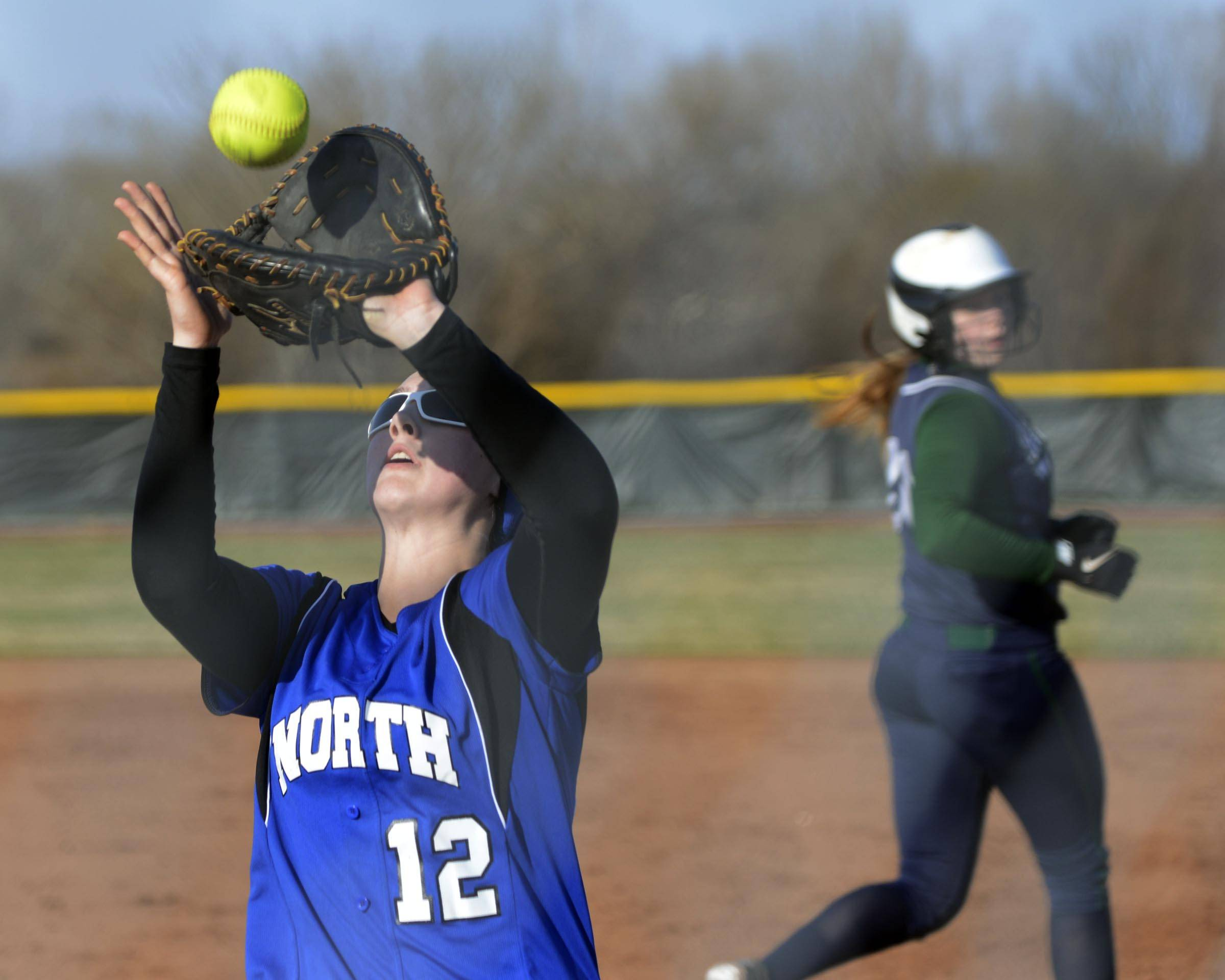 St. Charles North first baseman Abby Howlett catches a pop up earlier this year against Bartlett. Howlett homered in back-to-back games this week and like Troop above leads her team in RBI.