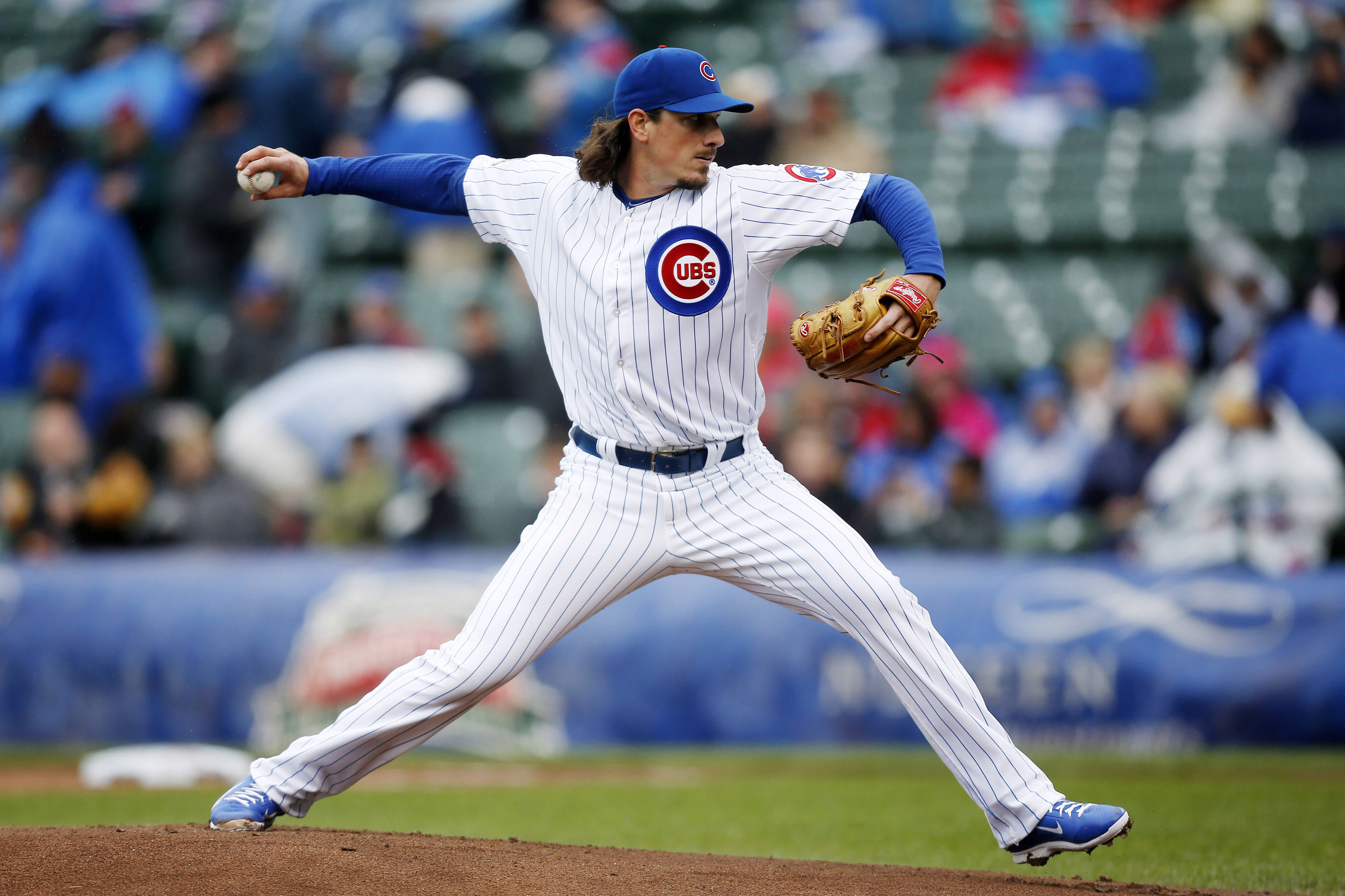 Chicago Cubs starting pitcher Jeff Samardzija delivers against the Milwaukee Brewers during the first inning of a baseball game on Friday, May 16, 2014, in Chicago.