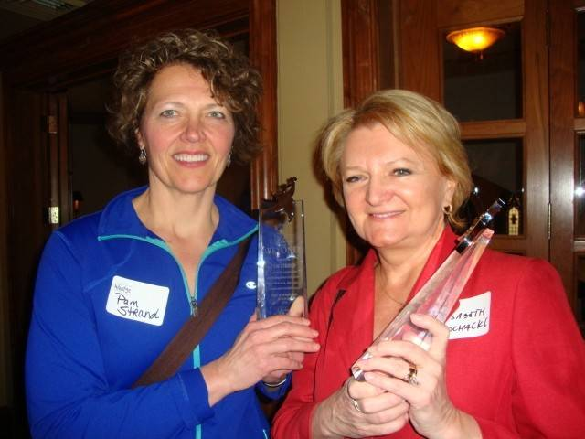 Pam Strand, left, and Elisabeth Sochacki of Strand Fitness accept the Spirit of Downtown Wheaton award.