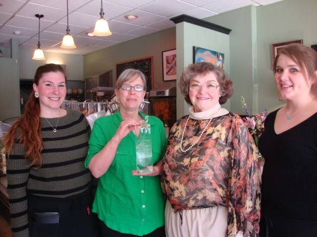 Employees of Suzette's Creperie accept the Business of the Year award from the Downtown Wheaton Association.