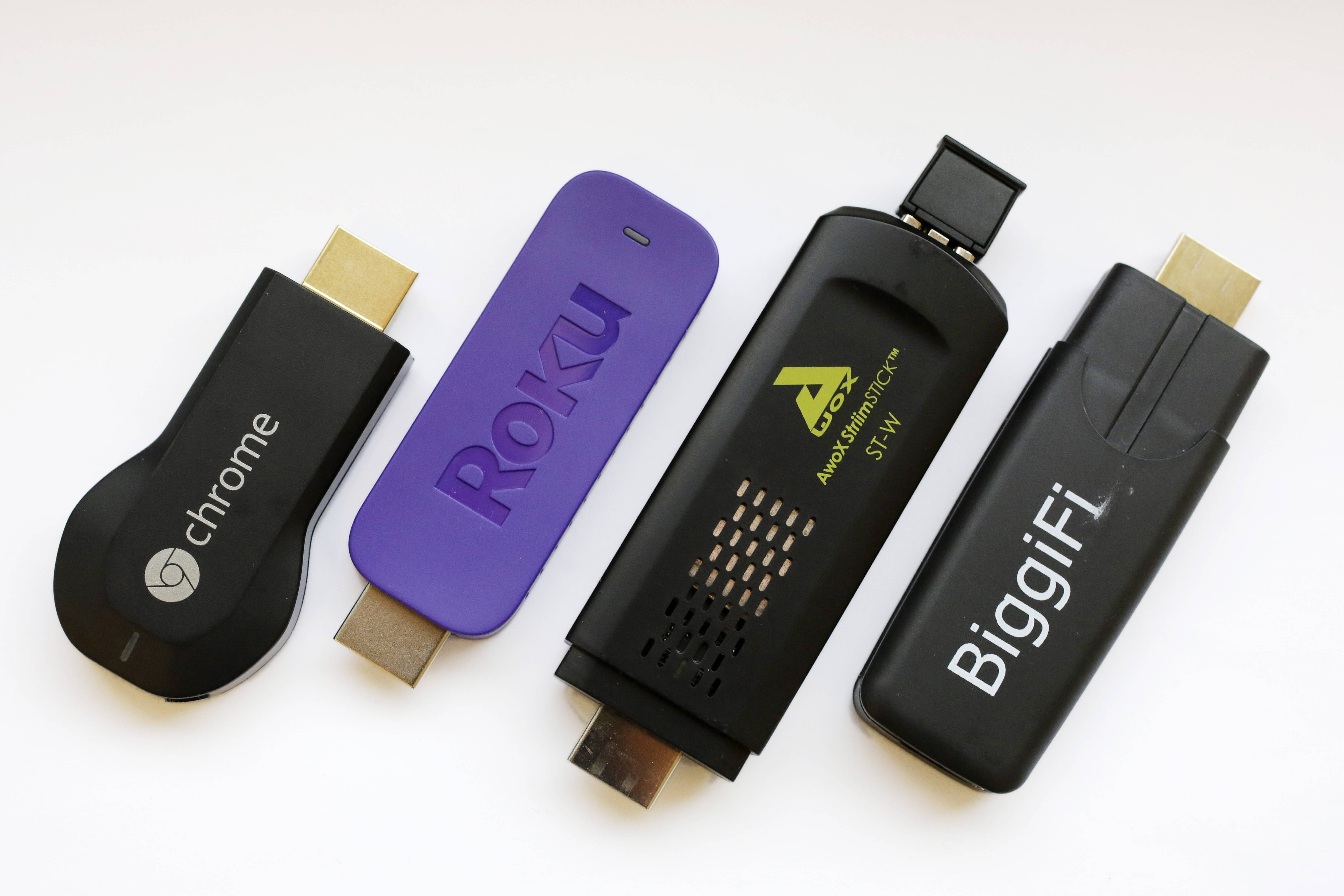 Google Chromecast, from let, Roku Streaming Stick, AwoX StriimStick, and BiggiFi.