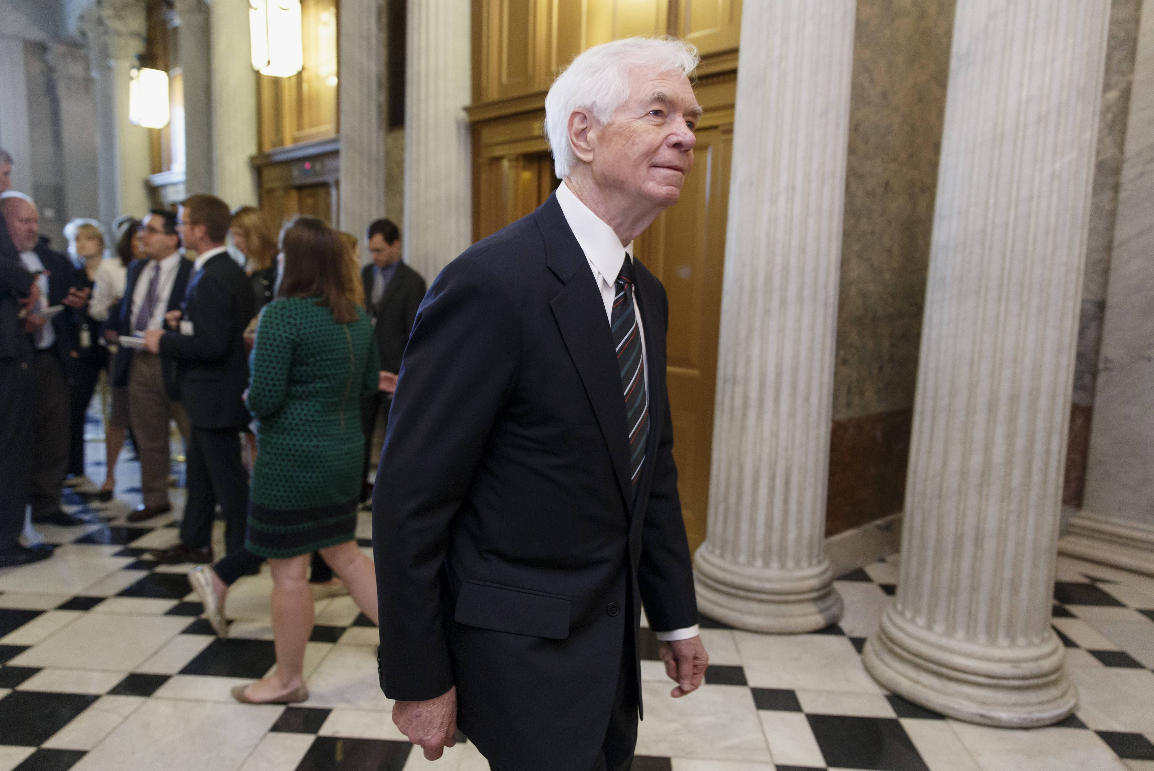 Sen. Thad Cochran, a Mississippi Republican, arrives at the Senate chamber Wednesday for a vote,