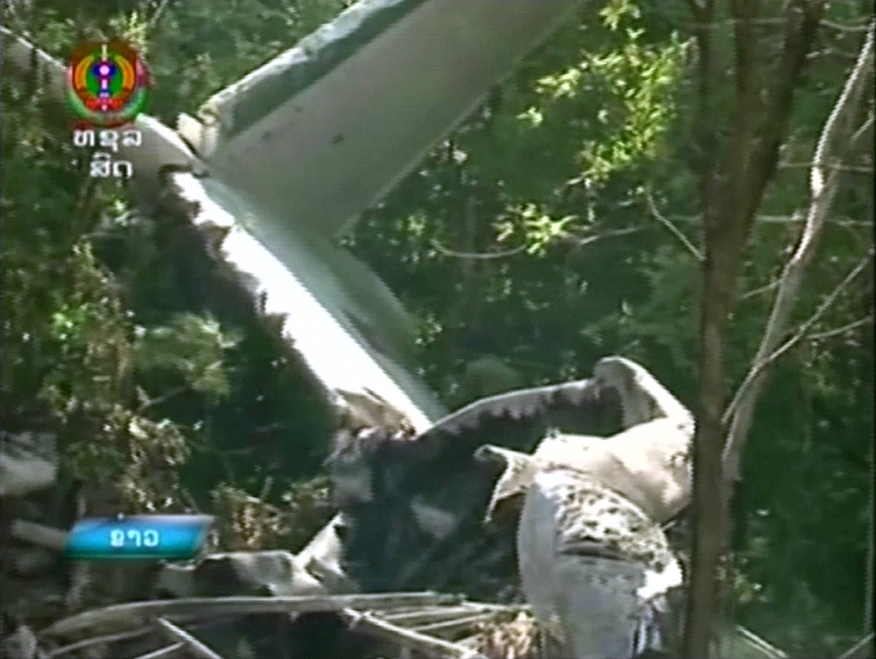 Associated Press This image taken from video provided by Lao National TV, shows the wreckage of a Lao air force plane which crashed in a forested area of Xiangkhoung province, Laos Saturday, May 17, 2014.