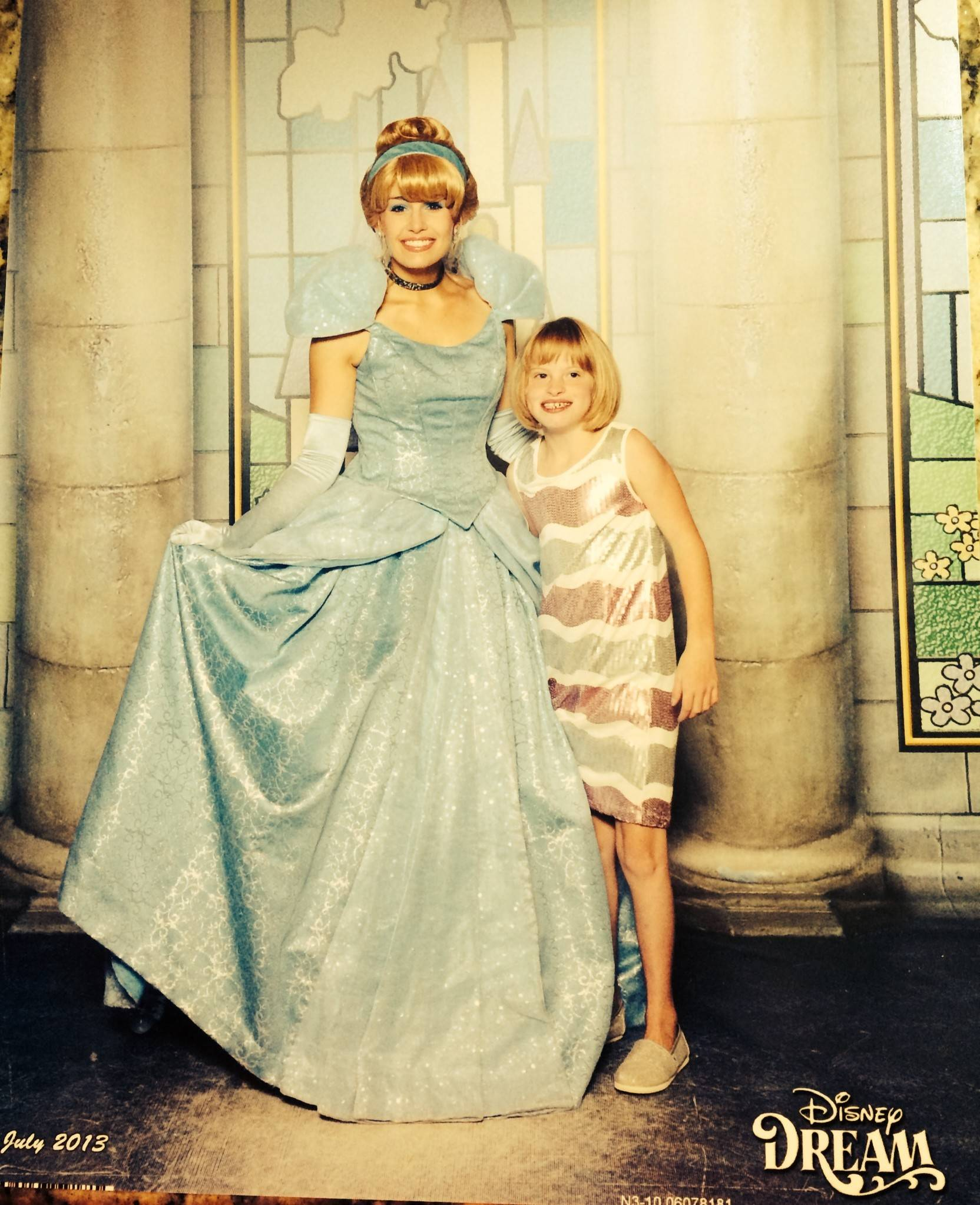 Grace Belmonte poses with Cinderella while on a Disney Cruise, part of her wish from the Make-A-Wish Foundation.