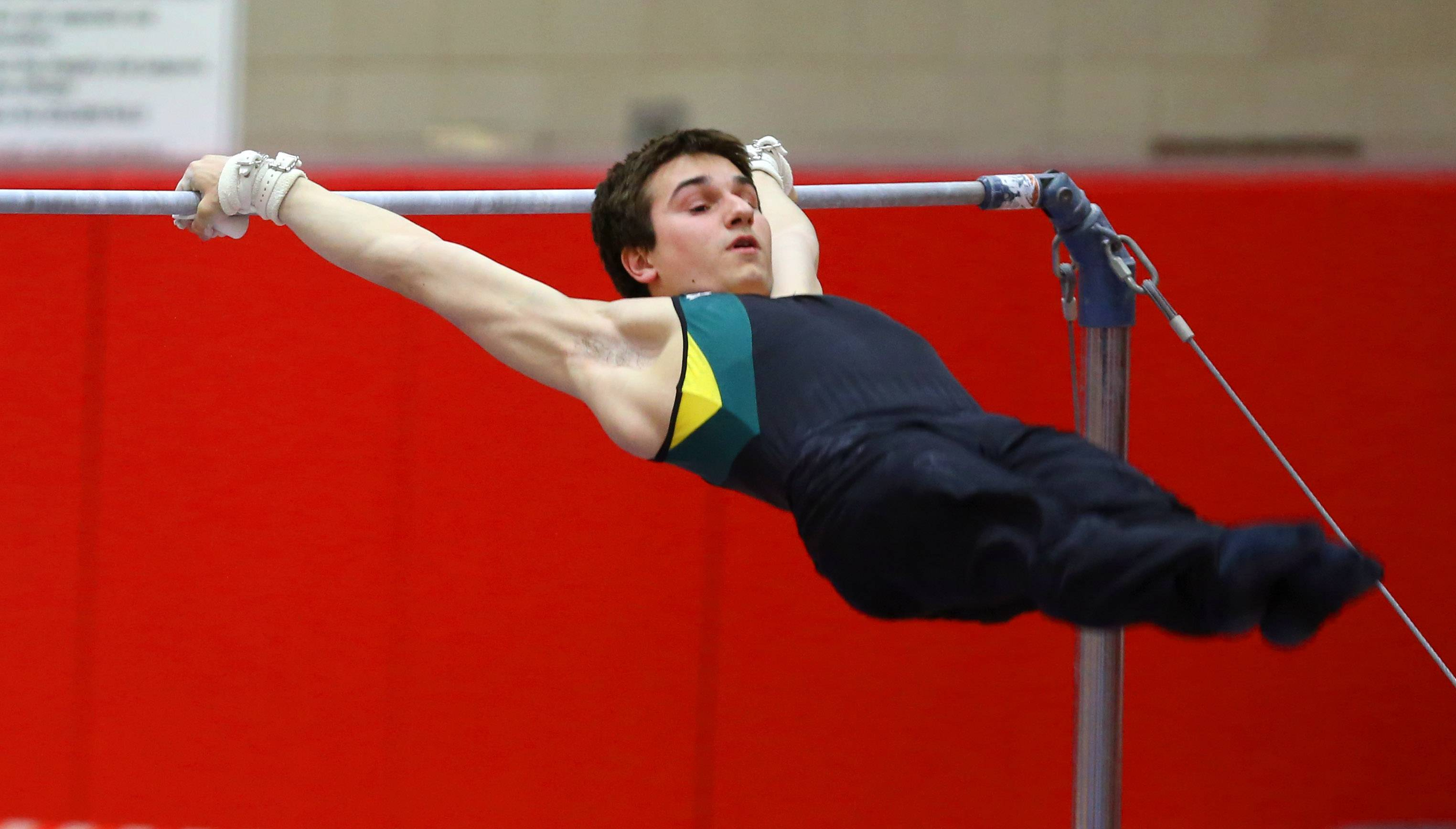 Stevenson's Zack Gilbert performs his horizontal bar routine during the boys gymnastics state finals Saturday at Hinsdale Central.
