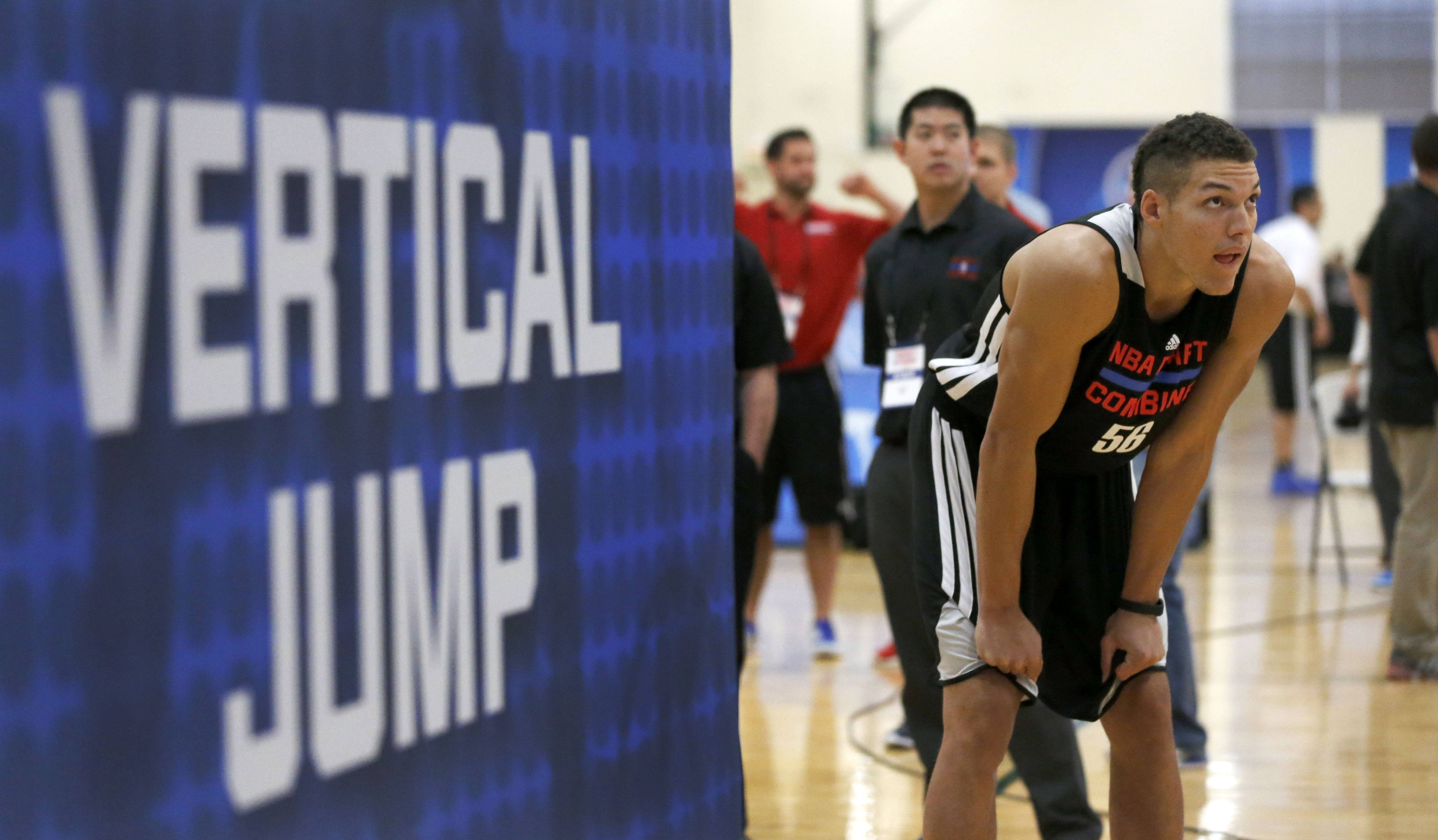 Aaron Gordon, from Arizona, waits to participate in the running vertical jump at the 2014 NBA basketball draft combine Friday, May 16, 2014, in Chicago.