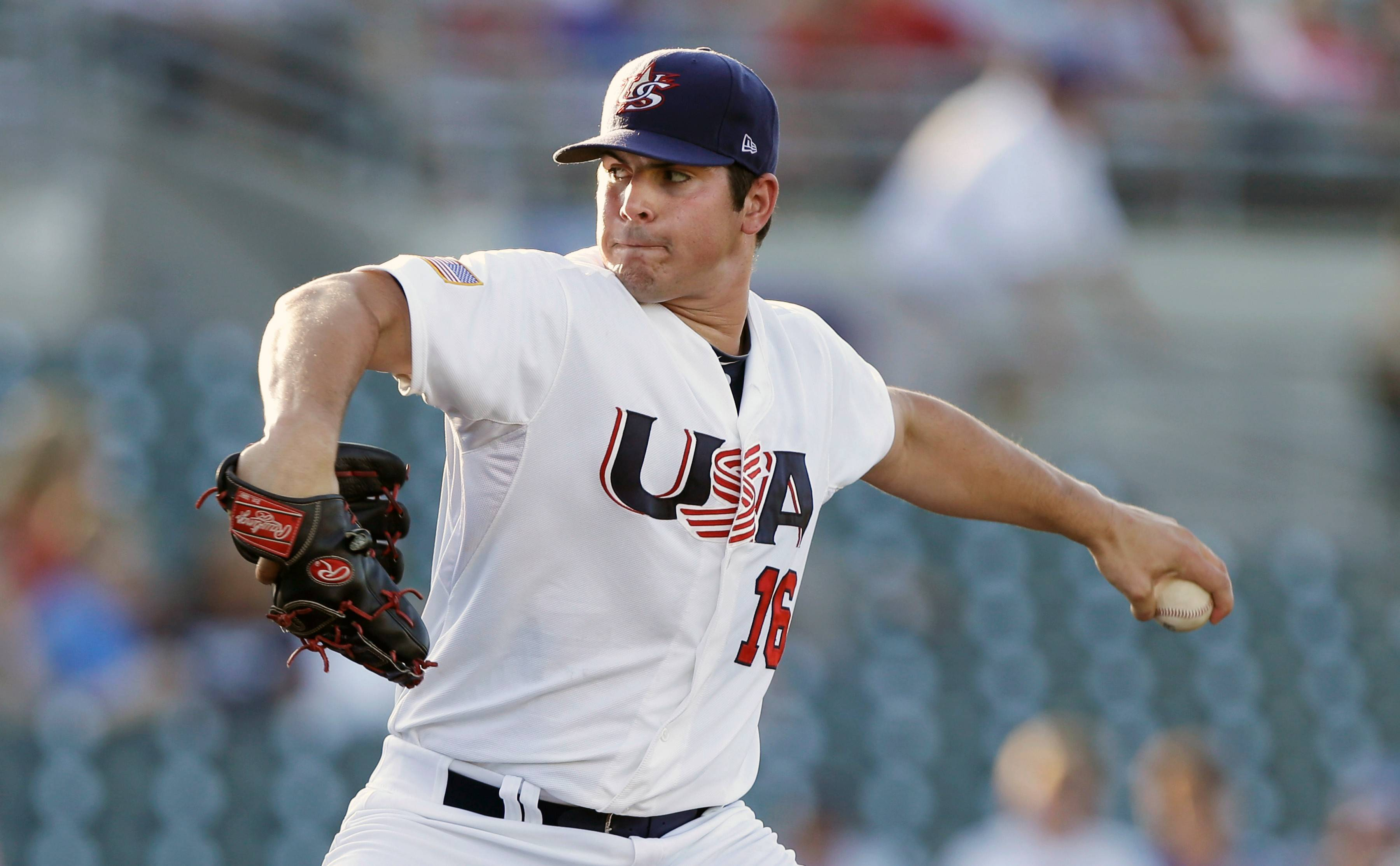 Carlos Rodon, here pitching for Team USA last summer in an exhibition game against Cuba, is expected to be the first pick in next month's baseball draft.