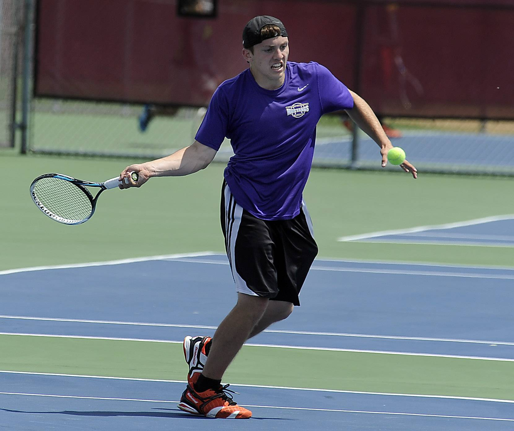 Rolling Meadows' Mack Galvin battles against Fremd's Eric Pohl in a singles semifinal matchup during Saturday's Mid-Suburban League touranment at Schaumburg.