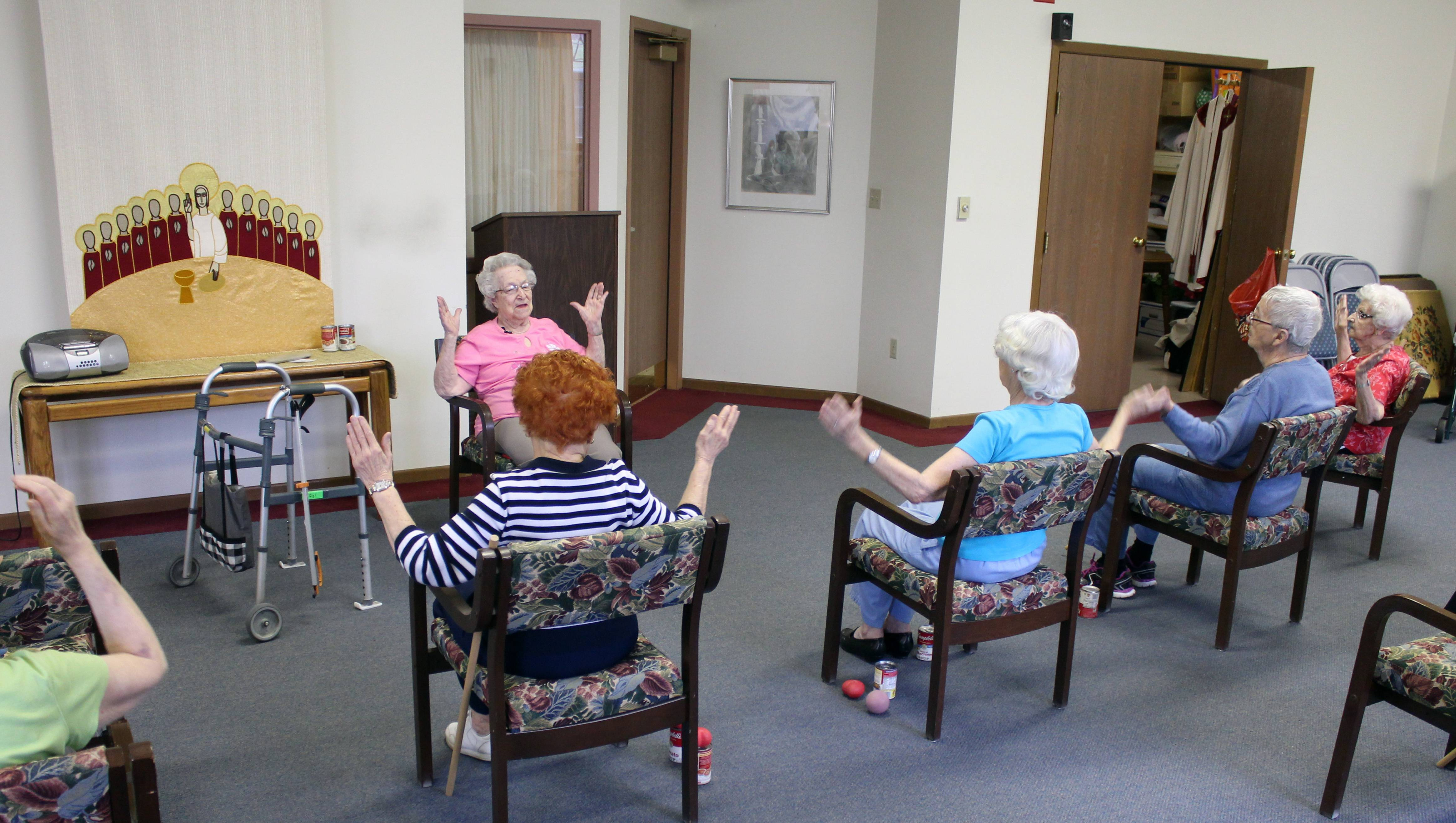 Hildegard Gigl leads a twice weekly exercise class at Hawthorne Terrace independent retirement center in Wauwatosa, Wis. Gigl, who turns 99 in June, is the oldest one in the class.