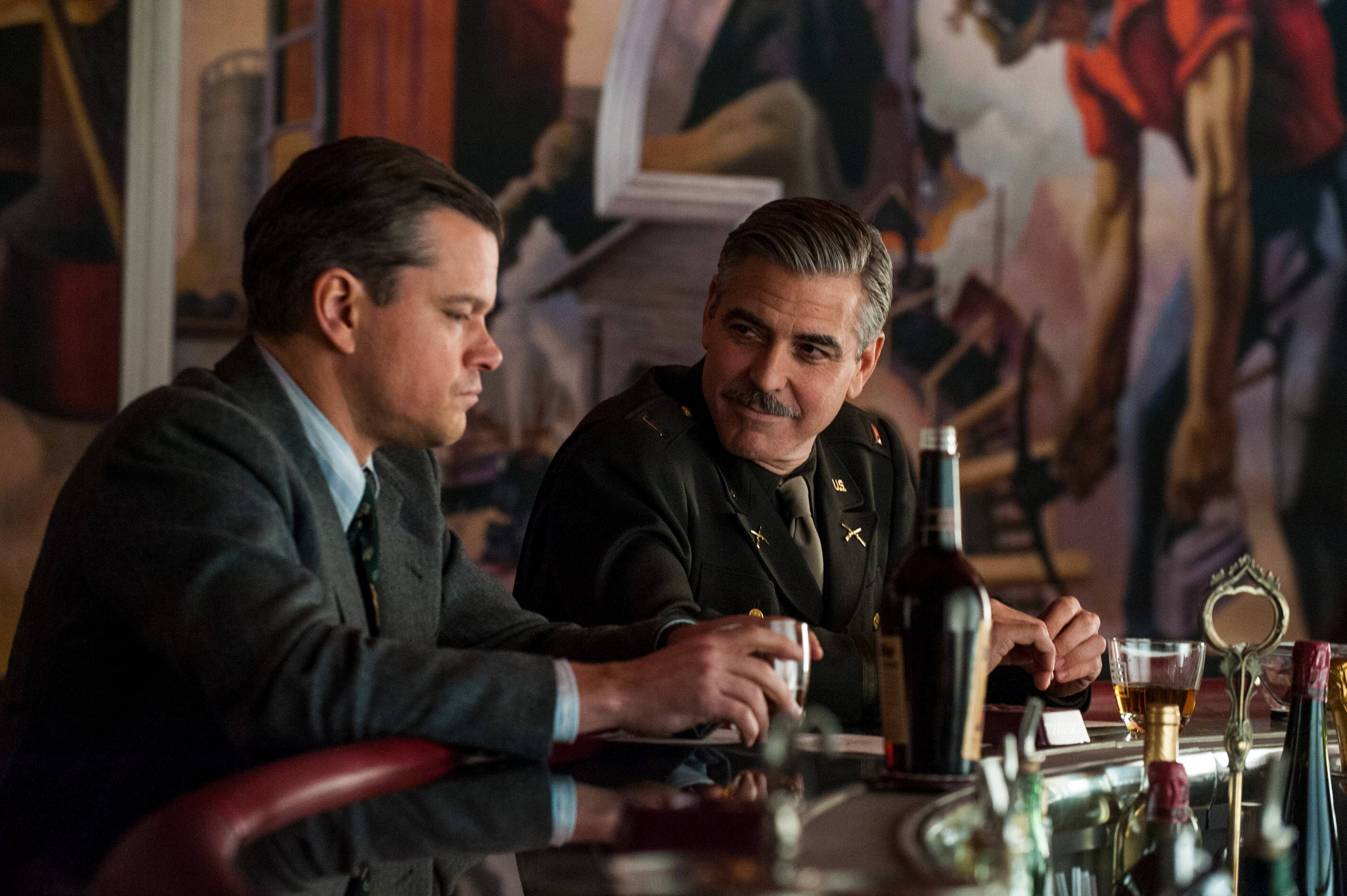 "Matt Damon, left, and George Clooney star in ""The Monuments Men."""