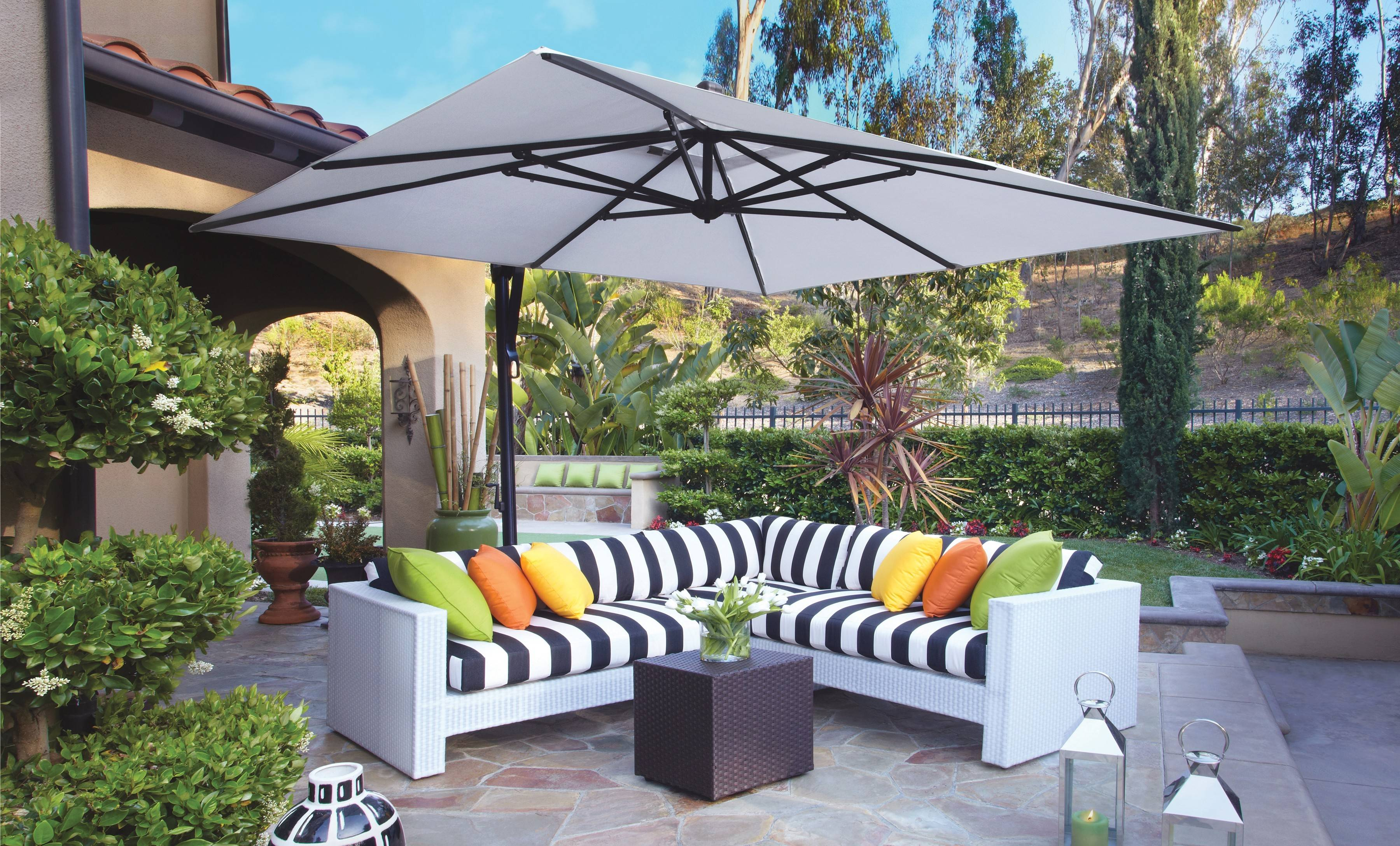 Patio umbrellas today can be freed from the table and shade a larger area.