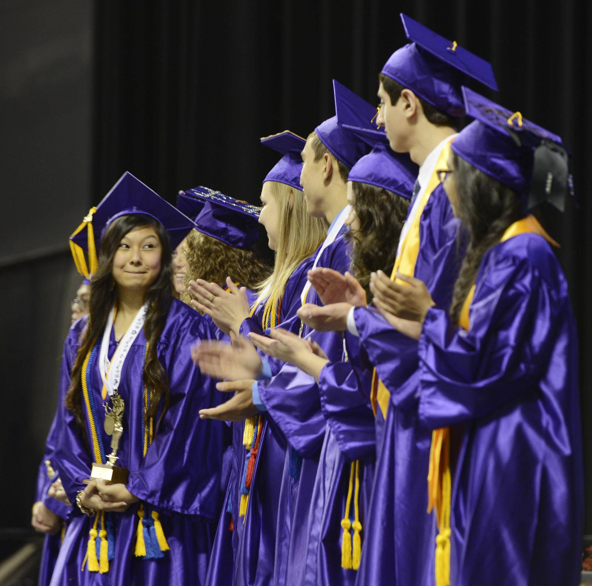 Honors Graduate Gabrielle Lopez looks at her classmates as a group of Honors students are introduced on stage Saturday at the Hampshire High School 2014 Commencement at the Sears Center in Hoffman Estates.