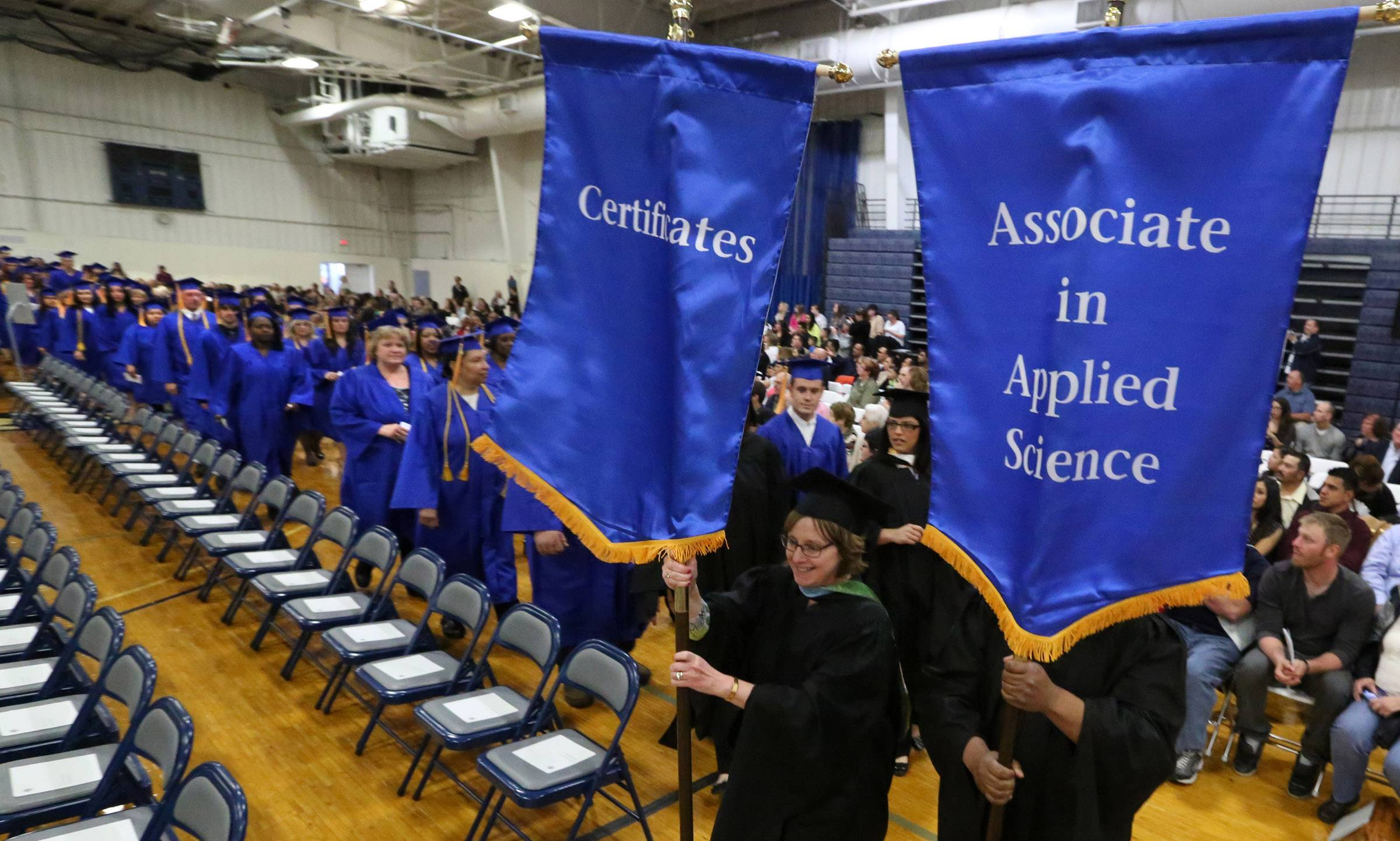 Graduates march in for College of Lake County's 45th commencement afternoon ceremony on Saturday in Grayslake.