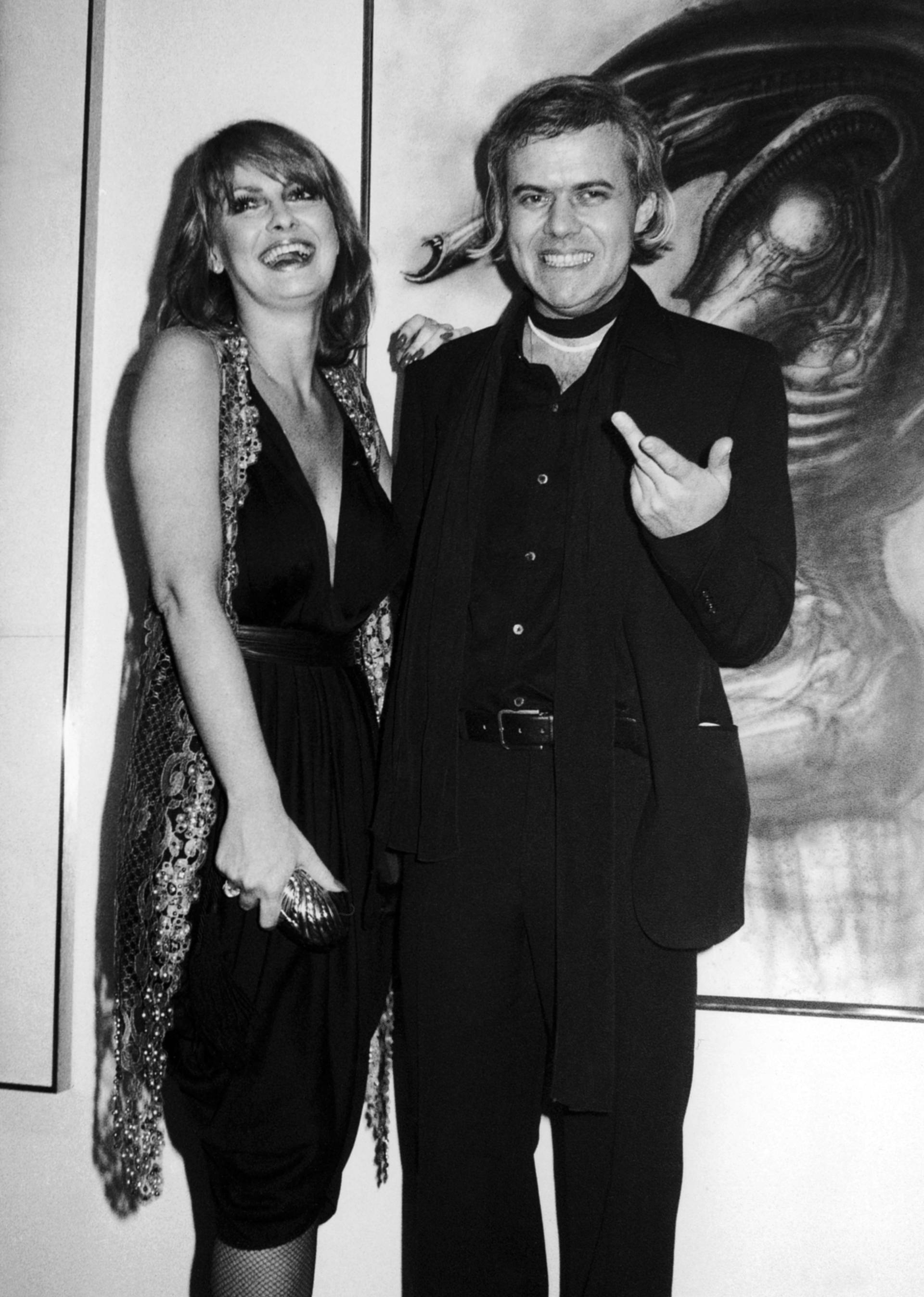 Swiss artist H.R. Giger,  right, poses with model Anneka Vasta at the opening of an exhibition in New York.