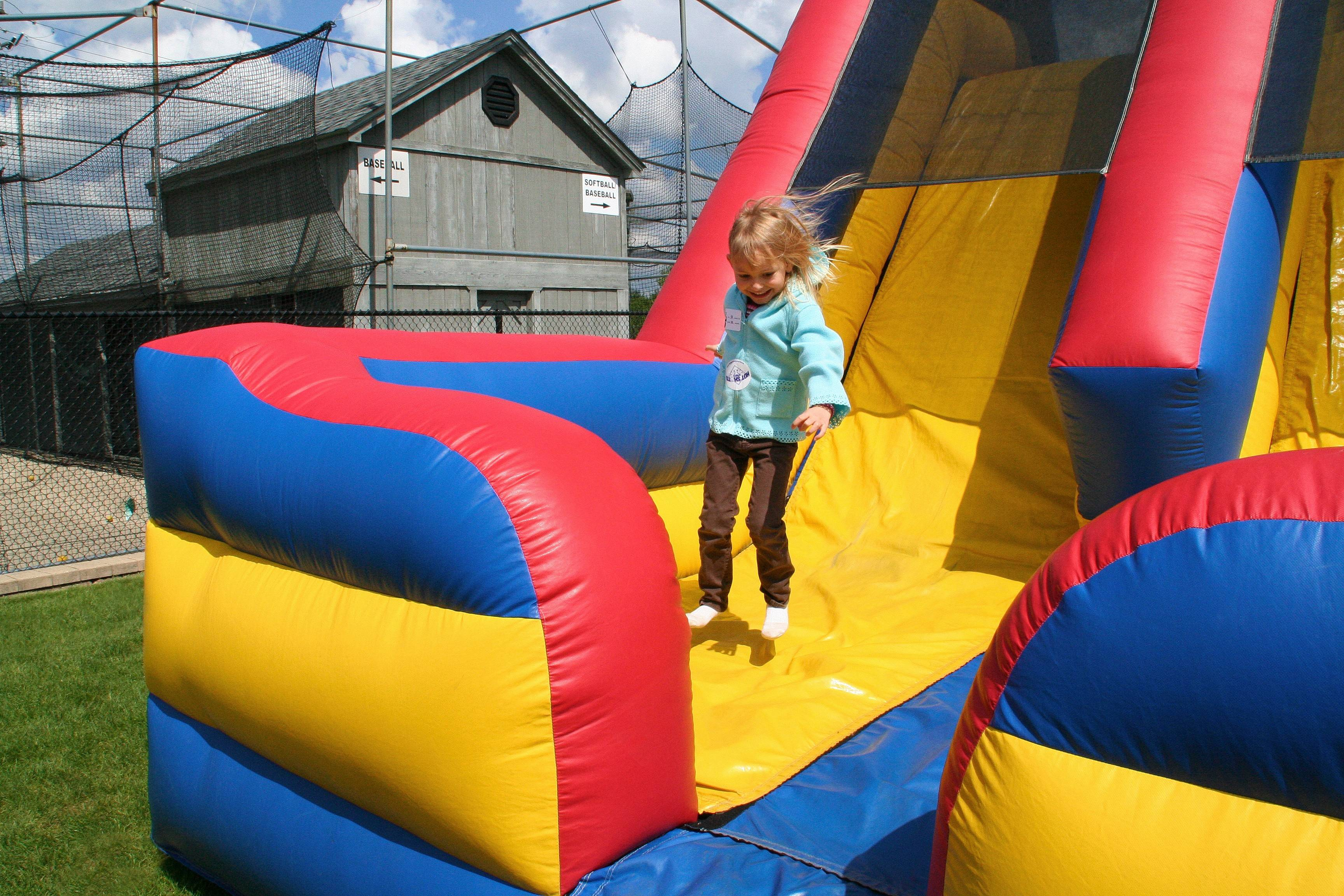 Alivia Owen bounces in the inflatable obstacle course Saturday at the Des Plaines Park District's Spring Fun Fair.