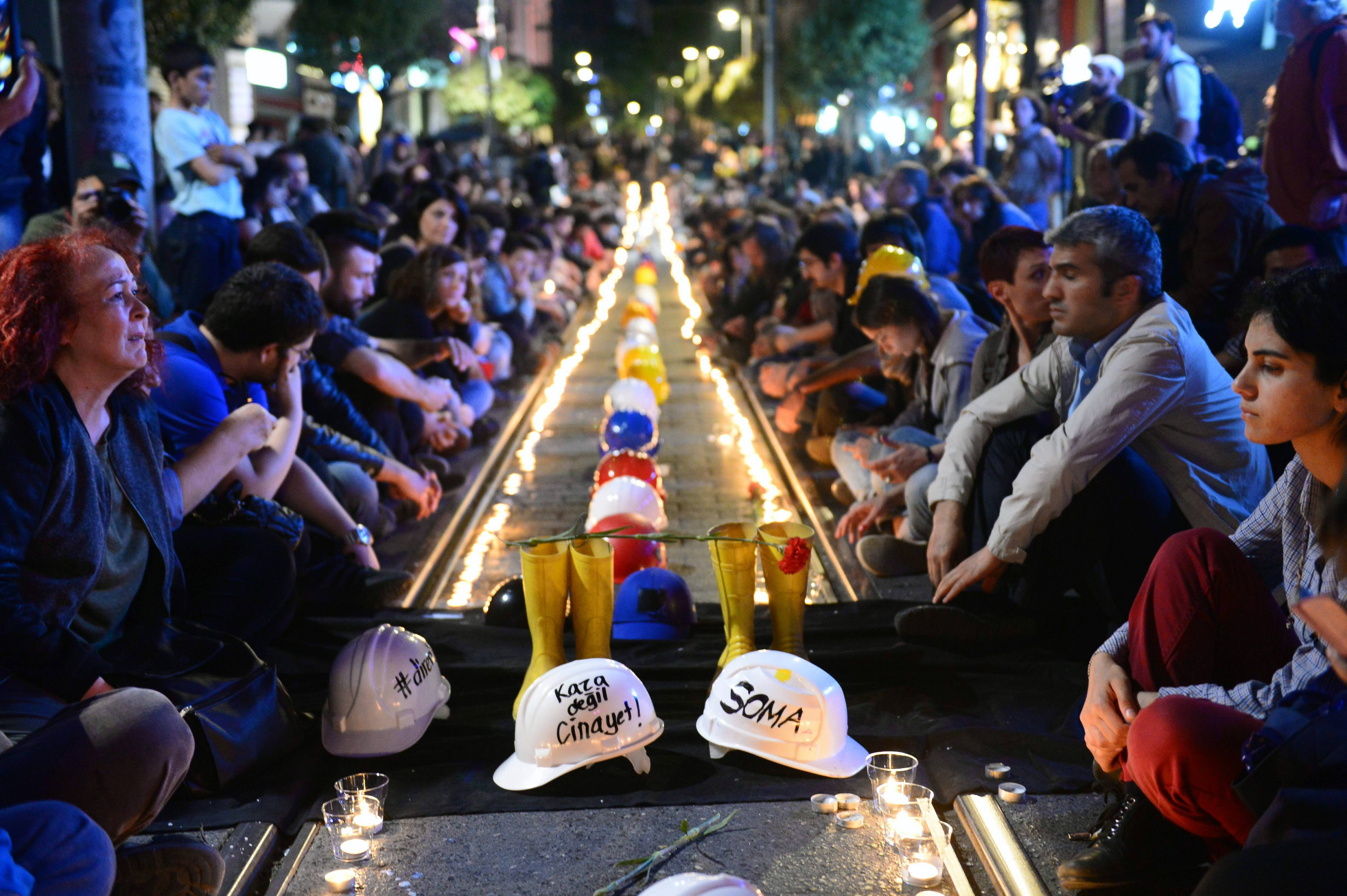 People gather late Friday to commemorate the Soma mine accident victims and protest the government's labor policy in Kadikoy, Istanbul, Turkey.