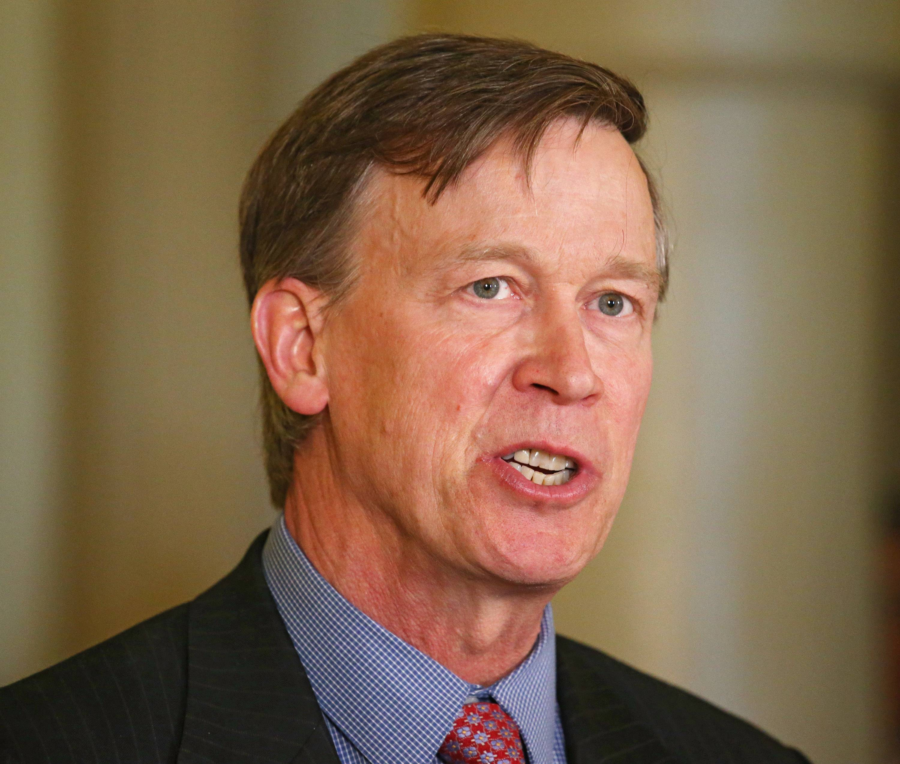Colorado Gov. John Hickenlooper speaks at a news conference Wednesday at the Capitol in Denver.