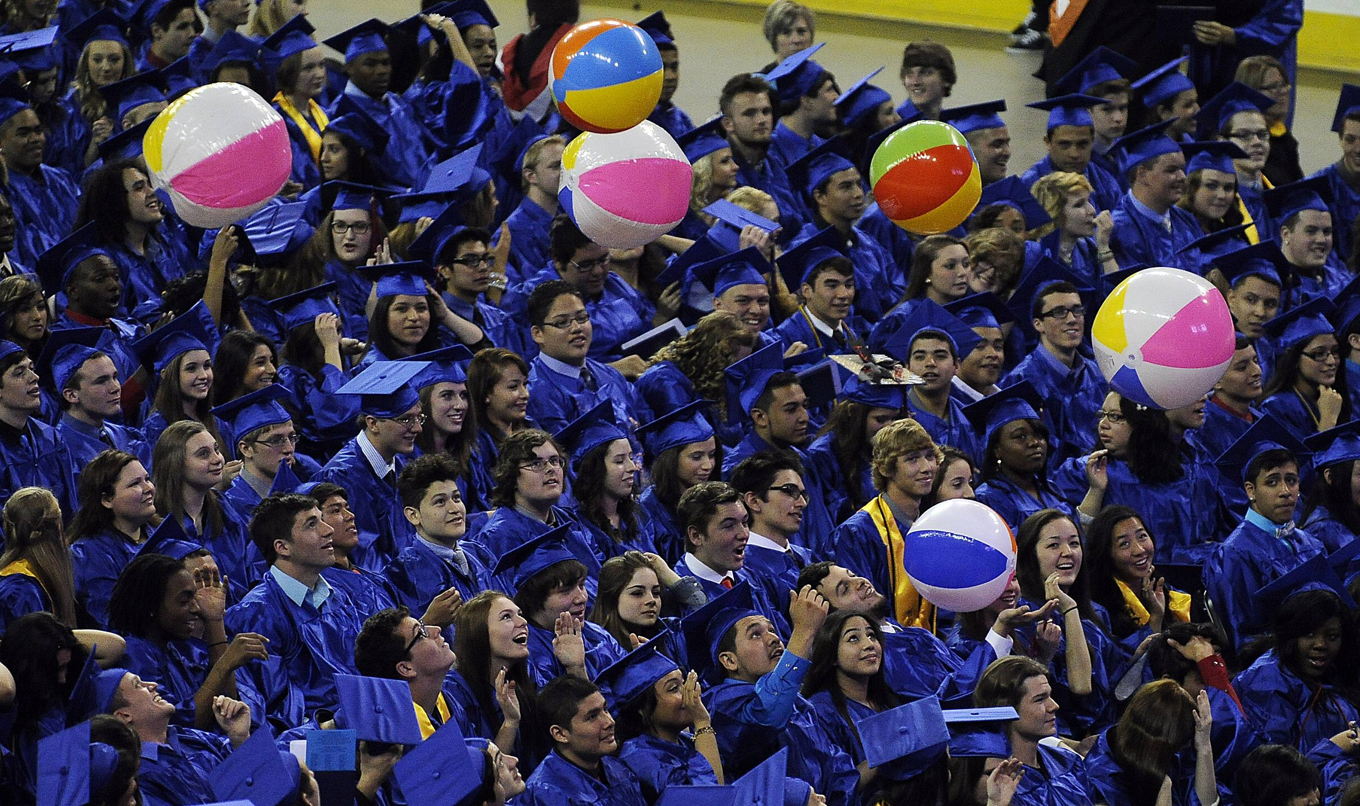 Let the party begin as the beach balls fly at the 31st Annual Commencement of Dundee-Crown High School at the Sears Centre in Hoffman Estates on Saturday.