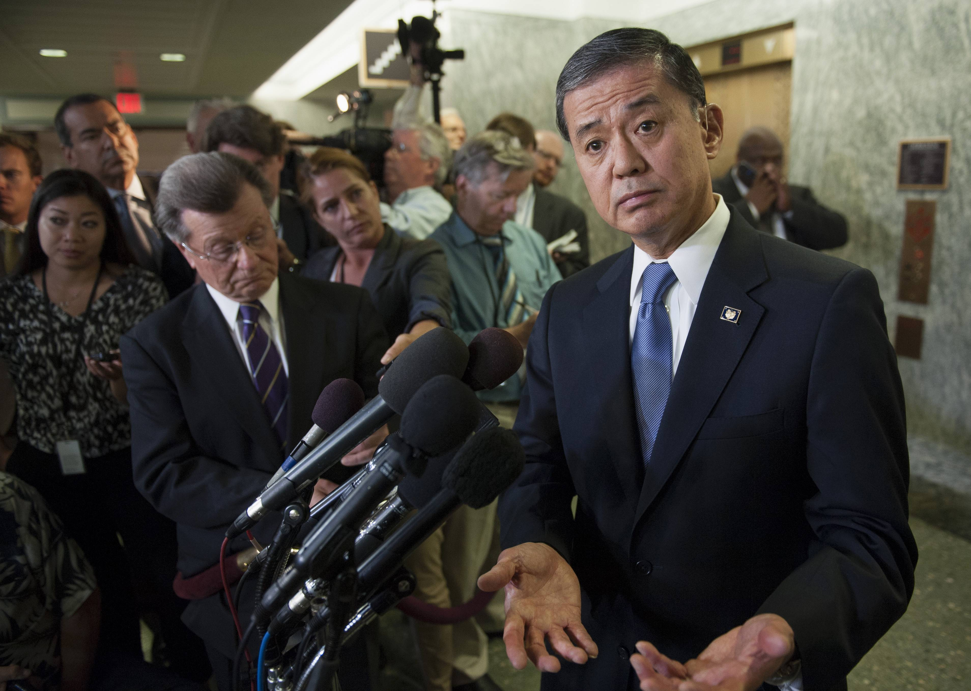 Veterans Affairs Secretary Eric Shinseki speaks with the news media Thursday on Capitol Hill in Washington.