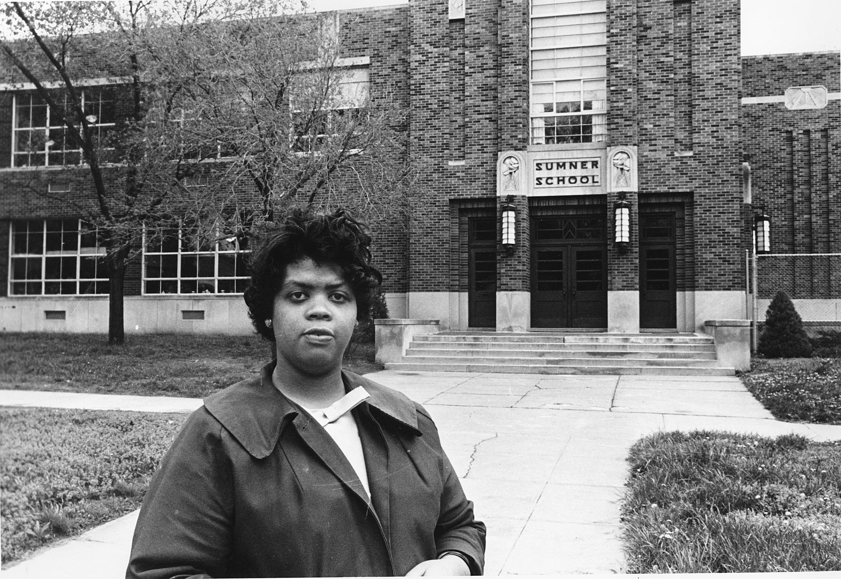 Linda Brown stands in front of the Sumner School in Topeka, Kansas in 1954. The refusal of the public school to admit Brown in 1951, then 9, because she is black, led to the Brown v. Board of Education of Topeka, Kansas.