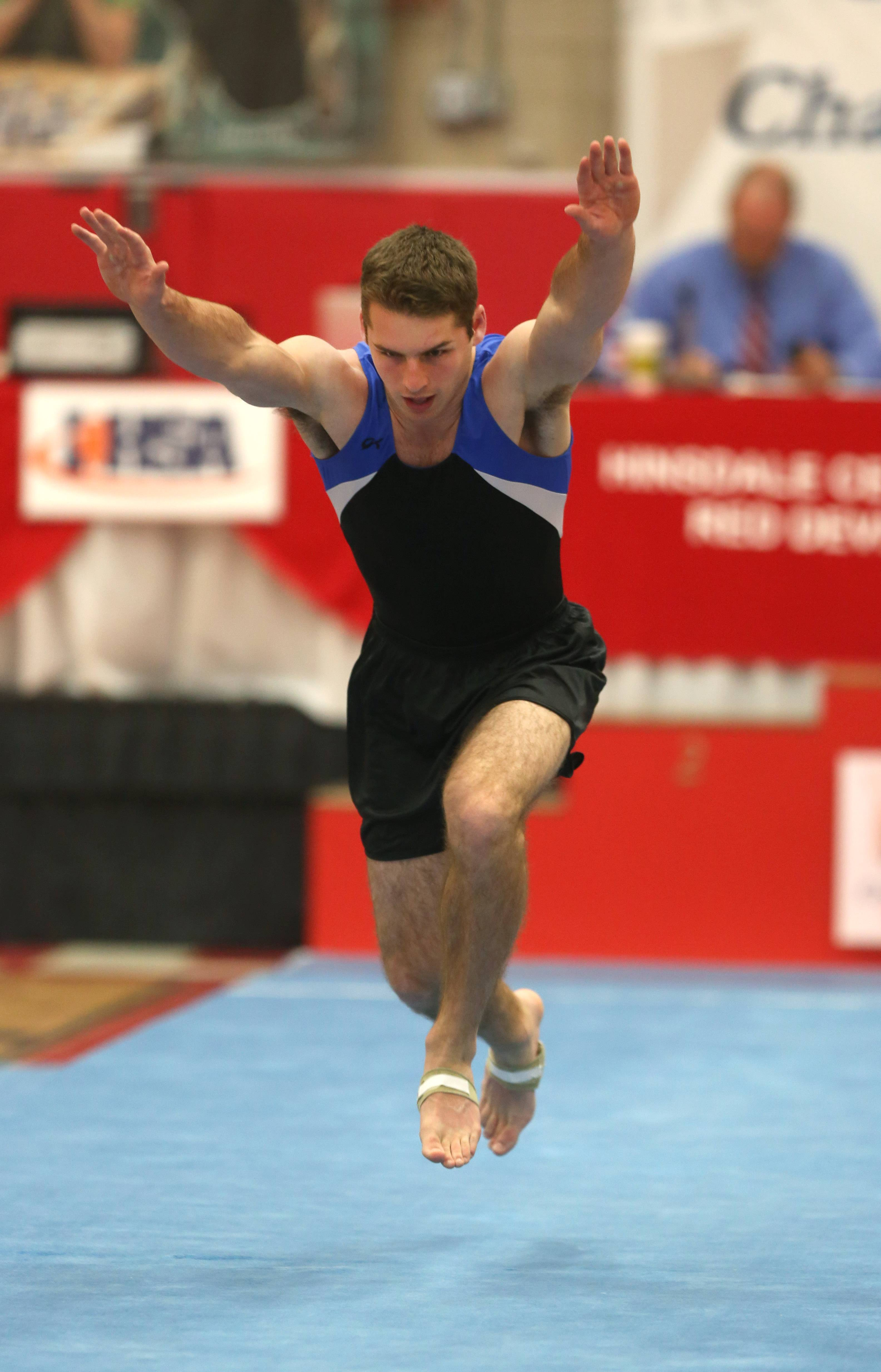 Wheaton Warrenville co-op's David MacDonald performs his floor excercise routine during the state boys gymnastics finals Saturday at Hinsdale Central.