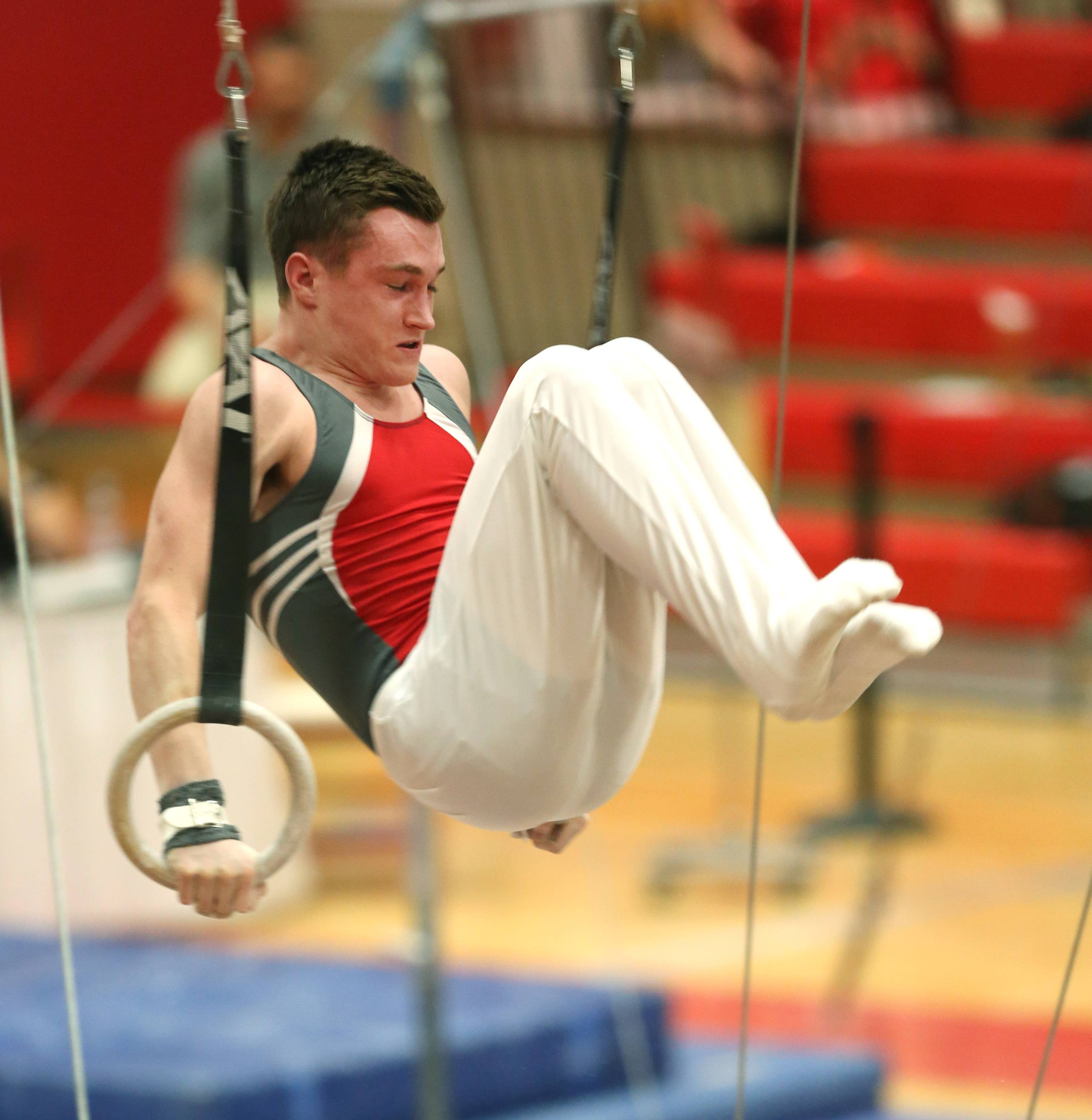 Mundelein's Cameron Mueller performs his still rings routine during the boys gymnastics state finals Saturday at Hinsdale Central.