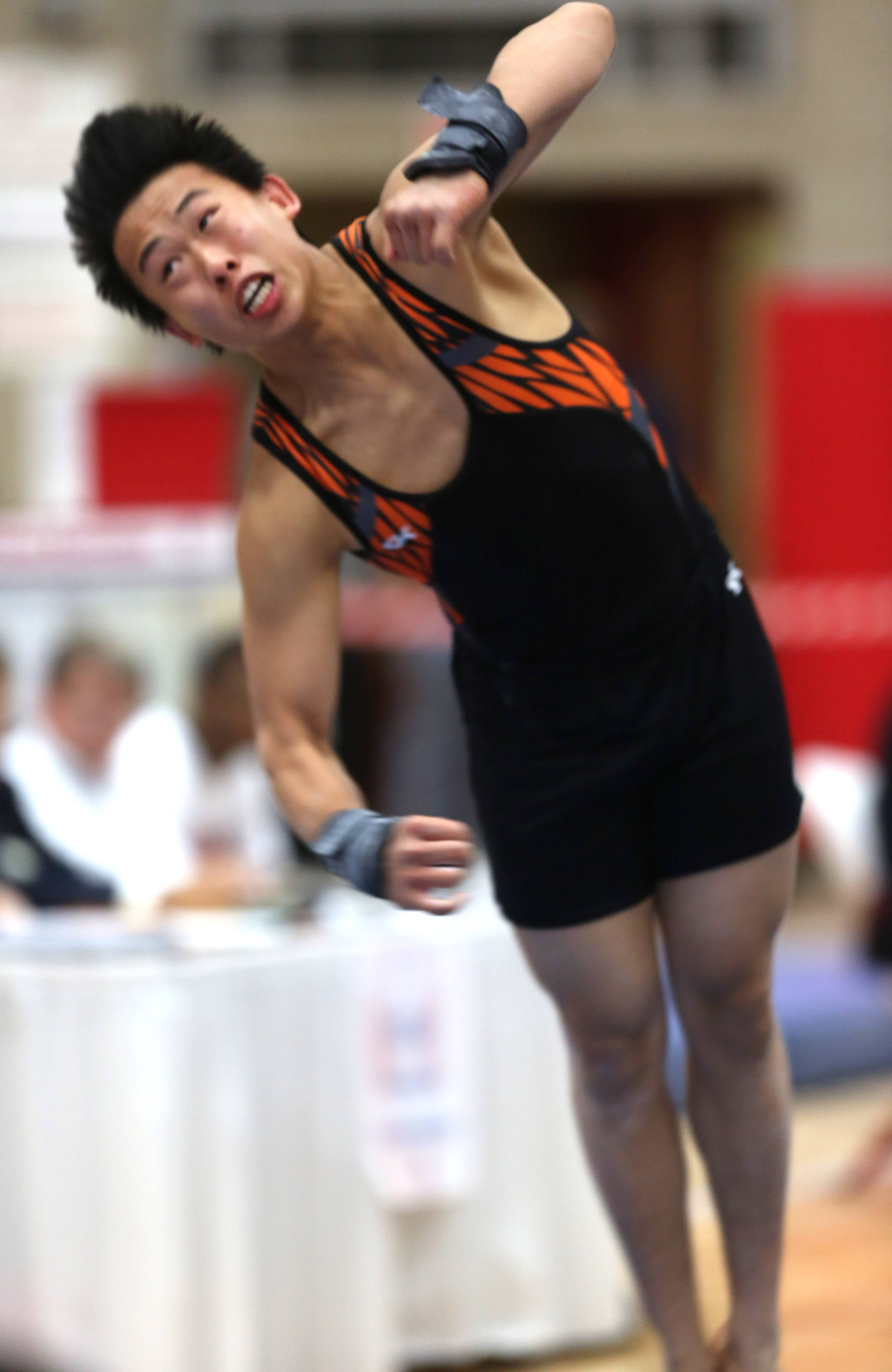 Libertyville's Alex Pong performs his floor excercise routine during the state boys gymnastics state finals Saturday at Hinsdale Central.