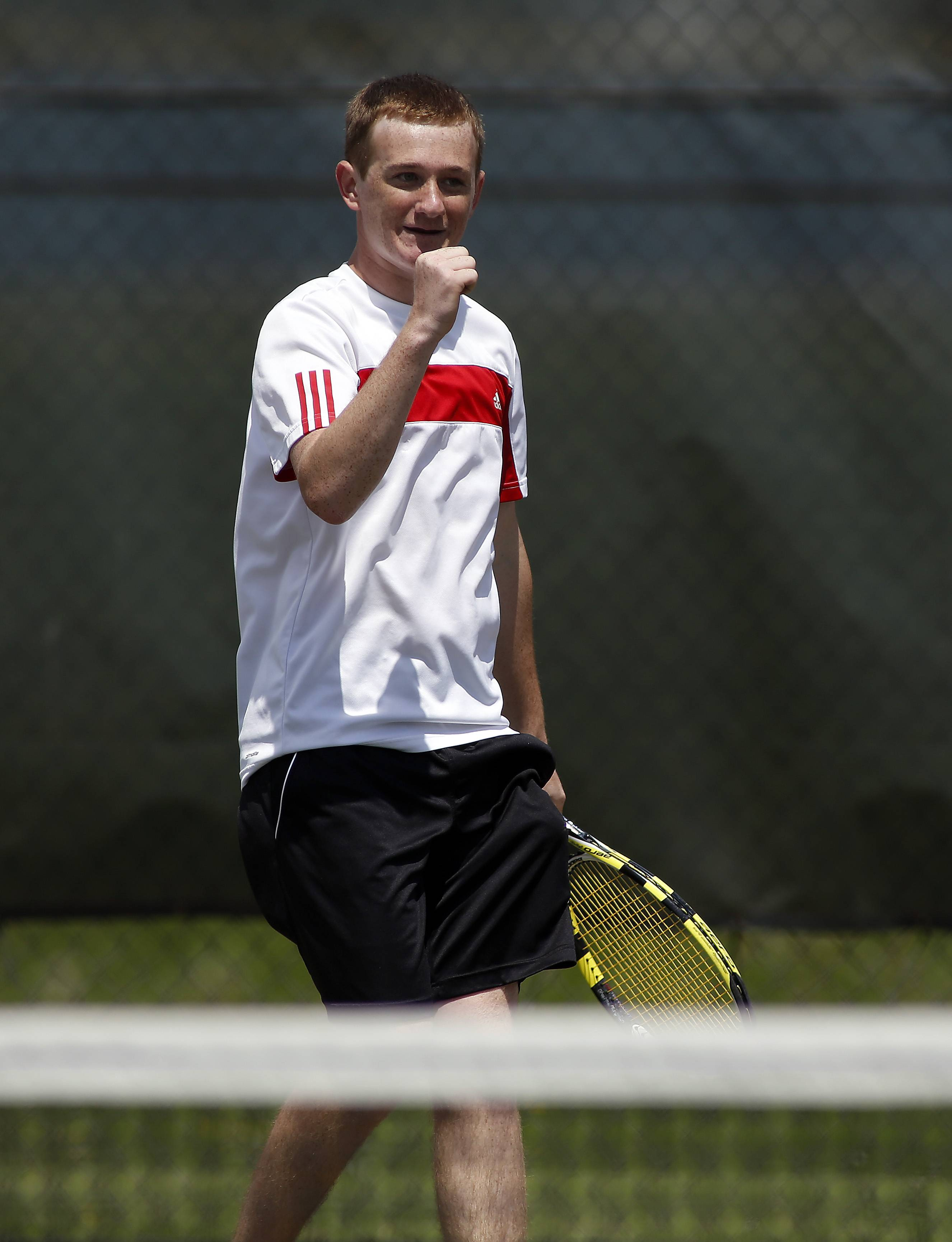 Batavia's Adam Maris reacts after winning a point against St. Charles North during the Upstate Eight Conference boys tennis tournament at Geneva High School Saturday.